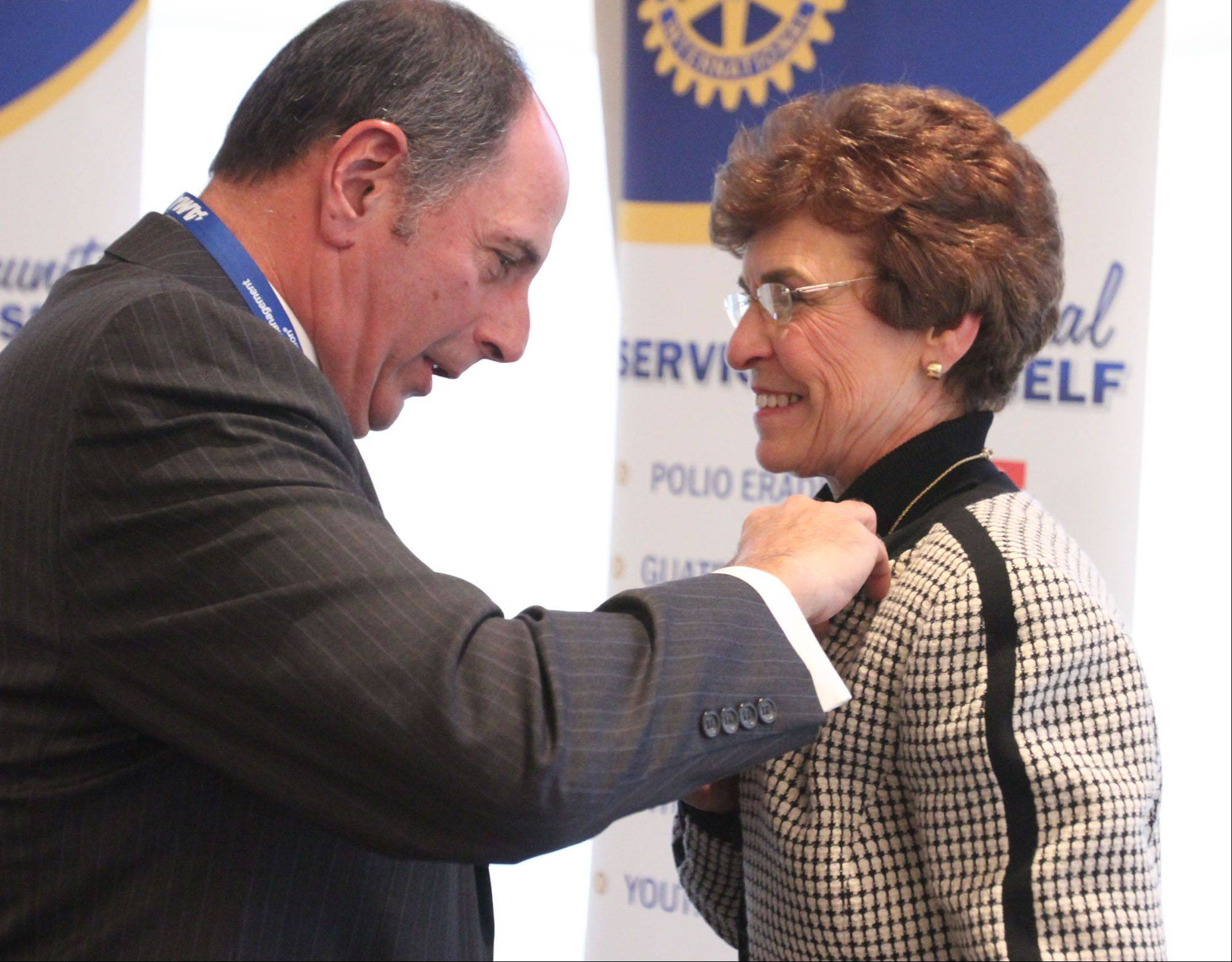 "Arlington Heights Rotary Club President Mark Tauber ""pins"" the mayor."