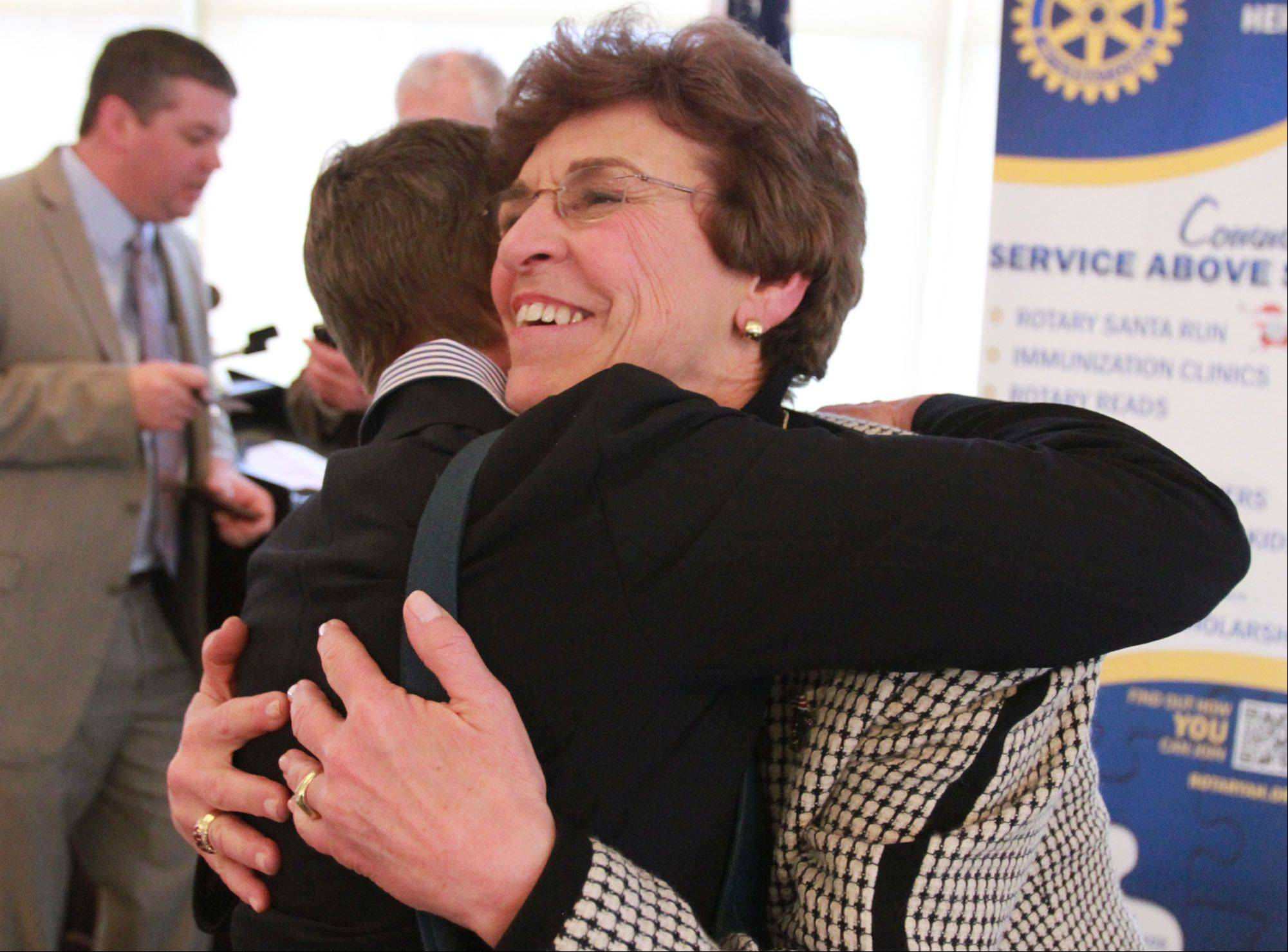 Arlington Heights Mayor Arlene Mulder hugs Linda Borton, Arlington Heights Rotary vice president, after her last State of the Village speech.