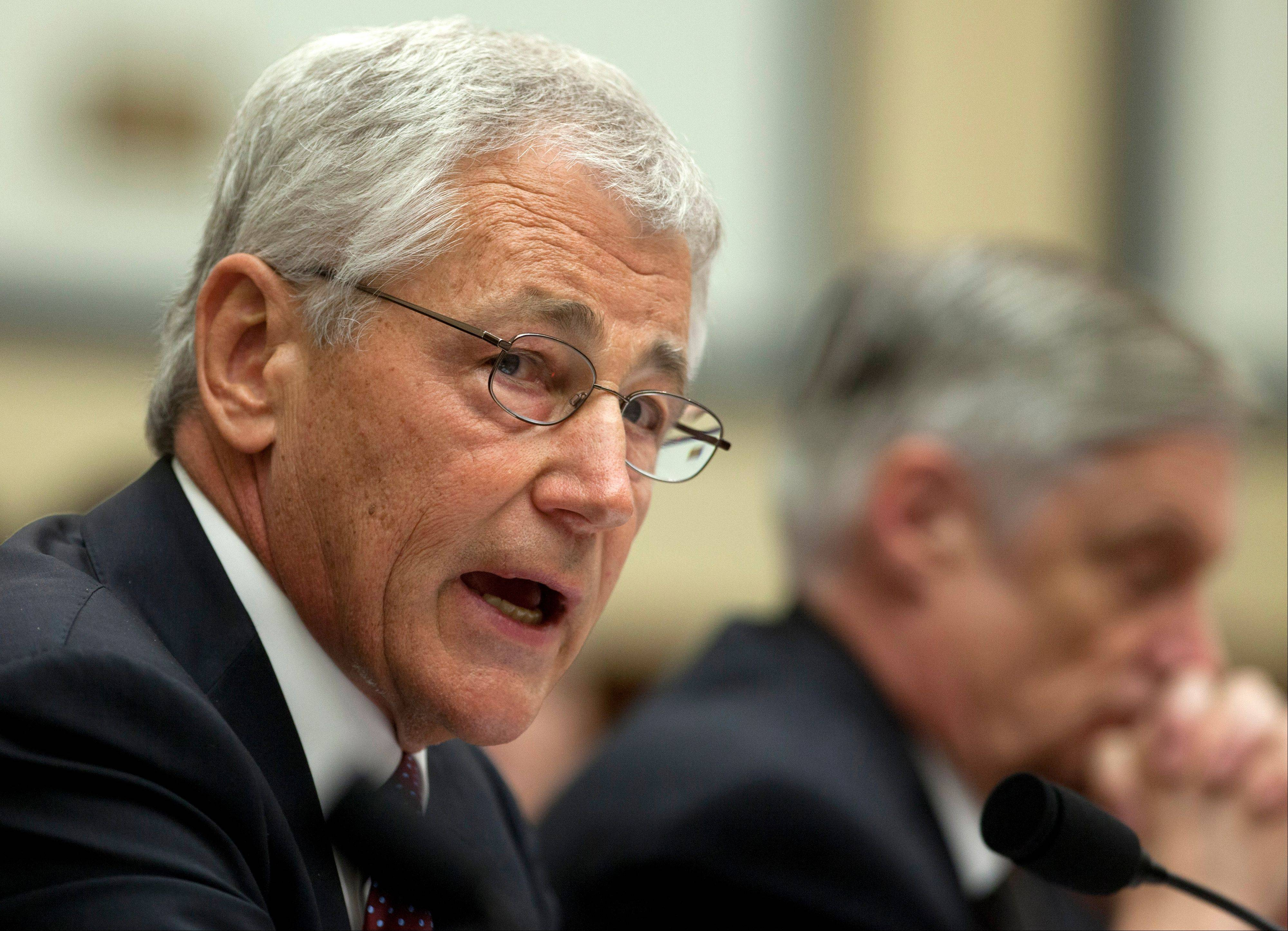 Defense Secretary Chuck Hagel, left, testifies on Capitol Hill in Washington, Thursday, April 11, 2013, before the House Armed Services Committee hearing on the Defense Department's fiscal 2014 National Defense Authorization Budget Request. At right is Defense Undersecretary, Comptroller Robert F. Hale.