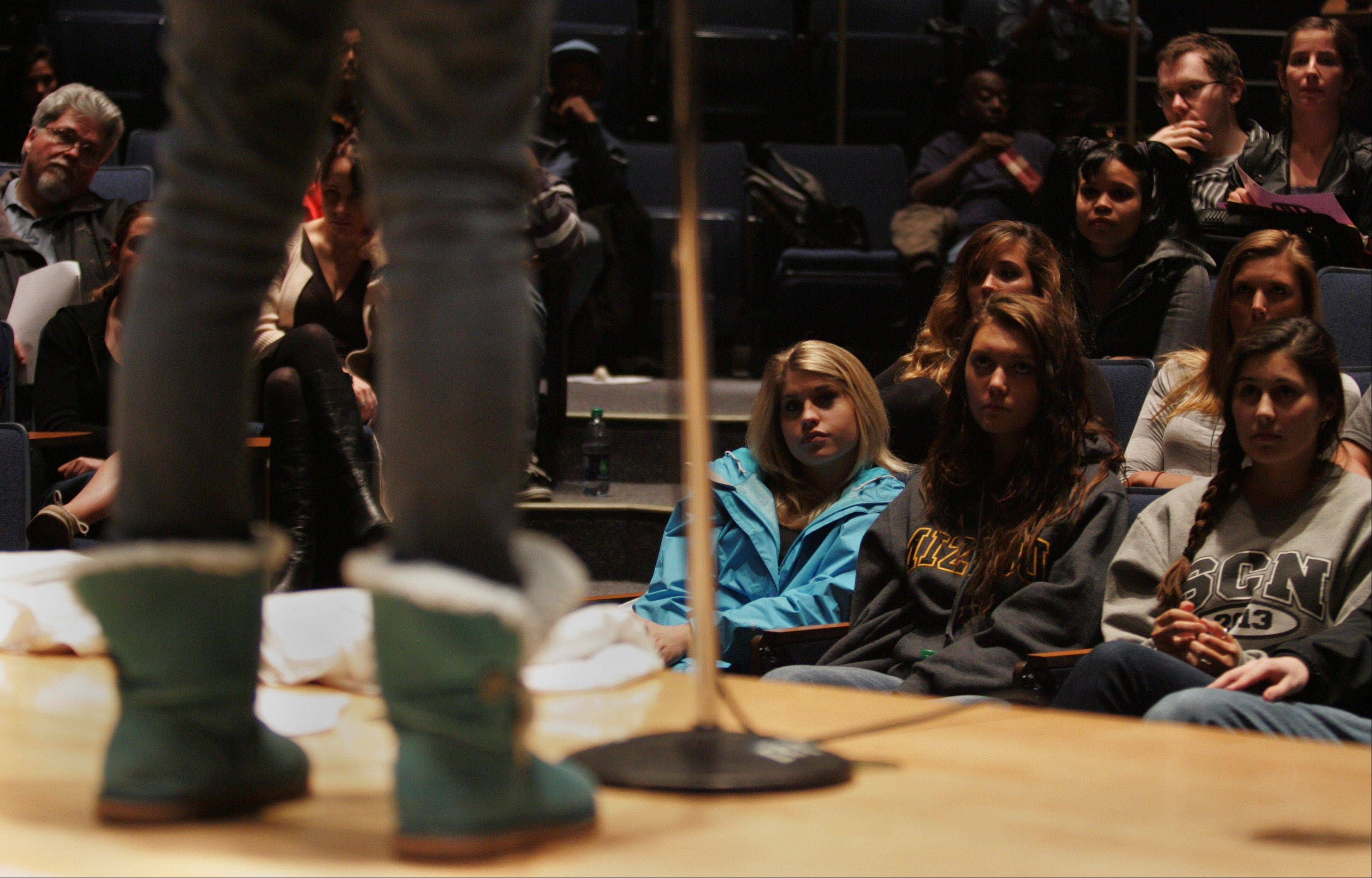 Students listen closely as a poem is performed Wednesday during the Poetry Slam at Elgin Community College.
