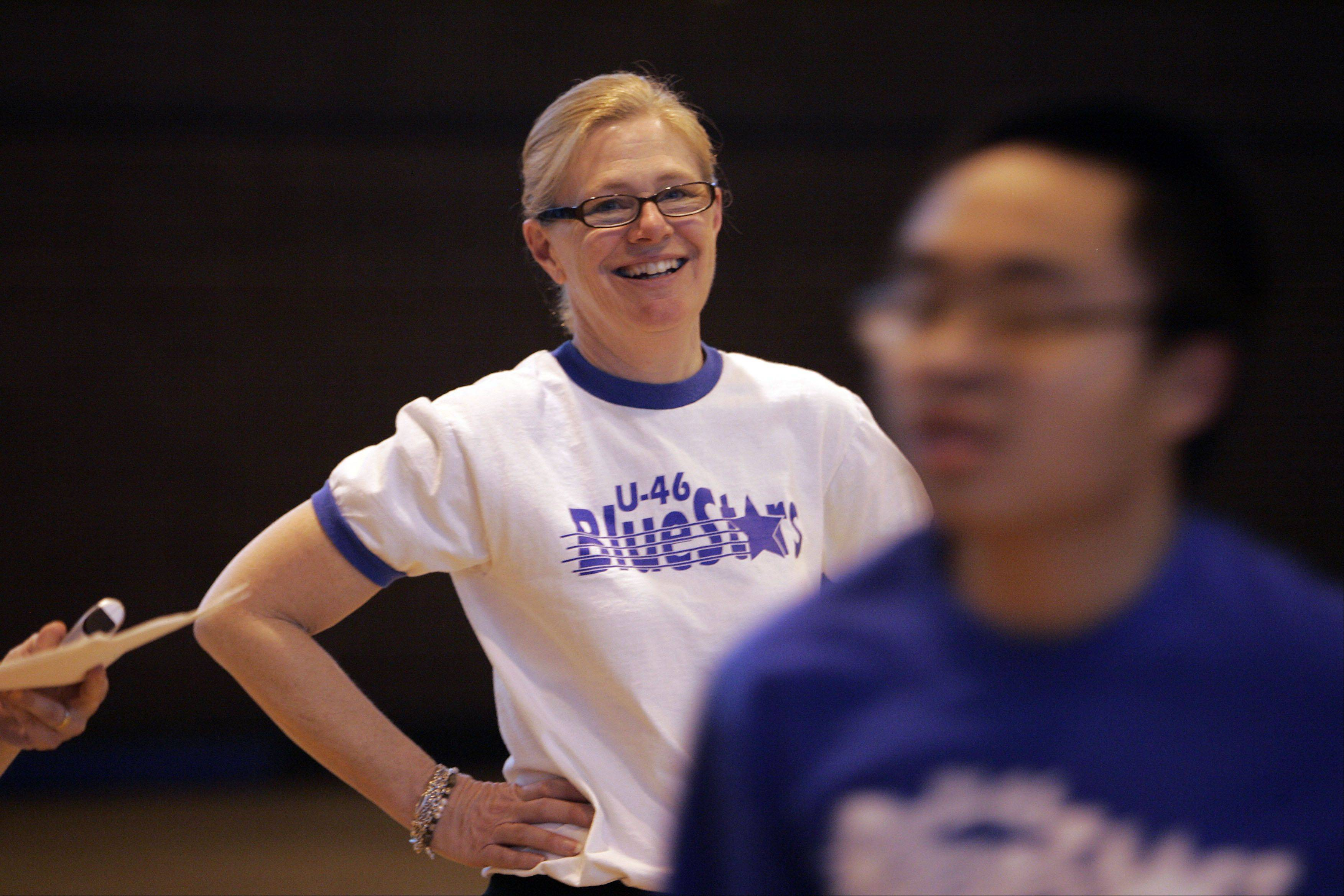 As coordinator of the Special Olympics program for all of Elgin Area School District U-46, Maureen Lue finds plenty to smile about as her BlueStars track and field team practices for the April 21 regional in Naperville.