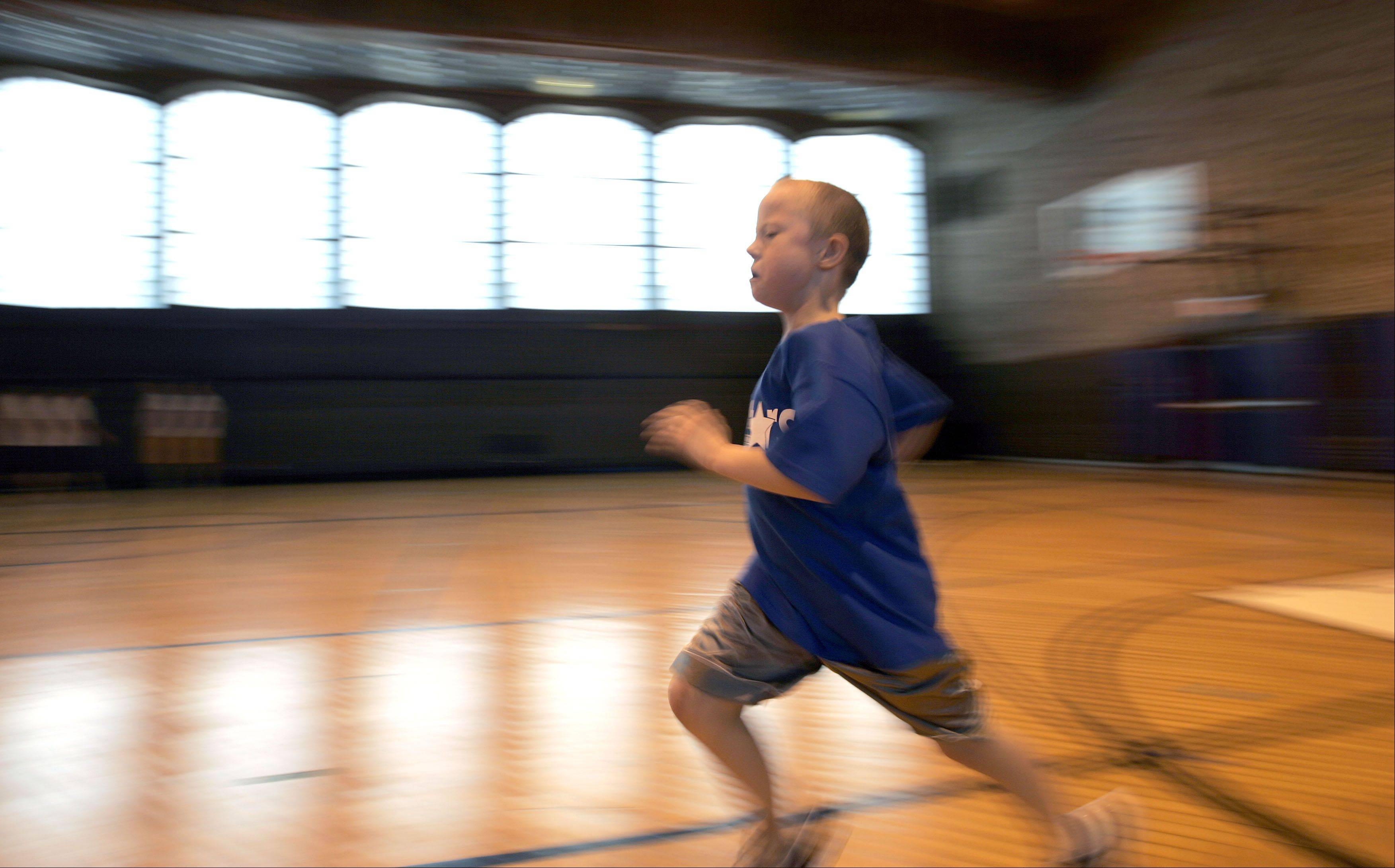 Ian Fergus works on the 200-meter sprint during practice for the U-46 BlueStars.