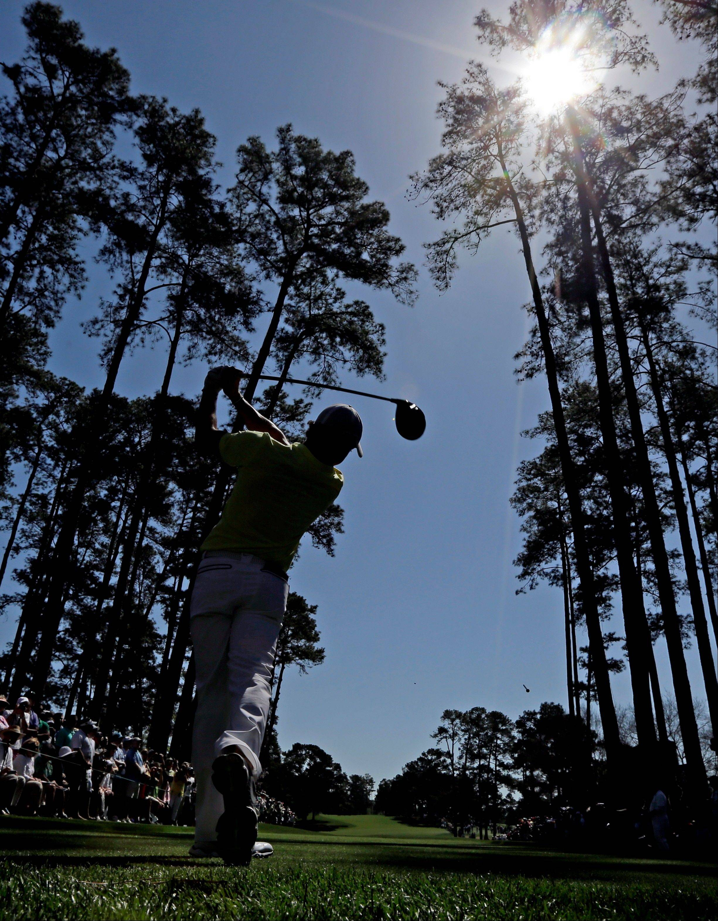 Rory McIlroy, of Northern Ireland, tees off on the 17th hole during a practice round for the Masters golf tournament Wednesday, April 10, 2013, in Augusta, Ga.