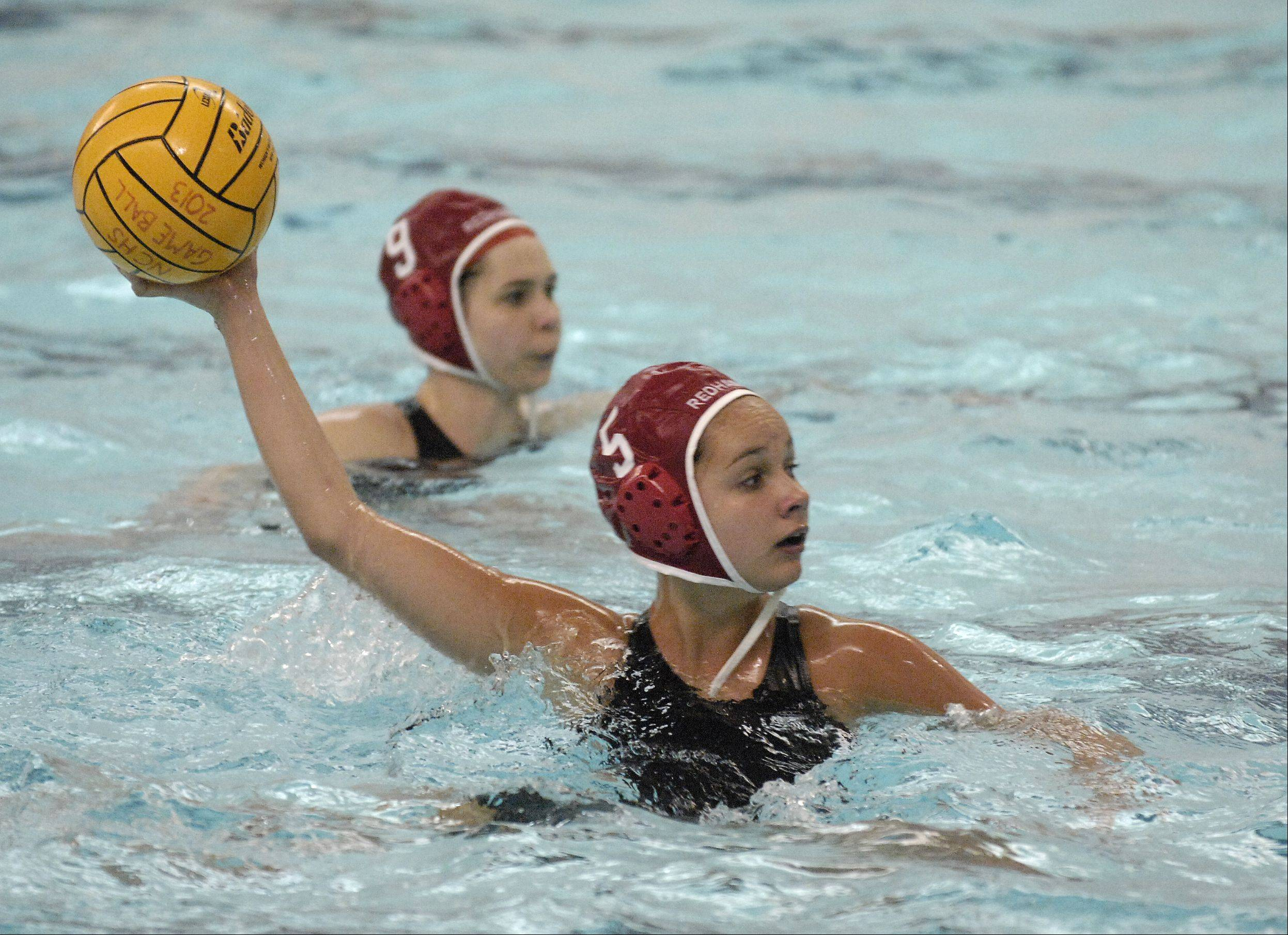 Kristina Alruve of Naperville Central plays against Neuqua Valley in varsity girls water polo at home, Thursday.