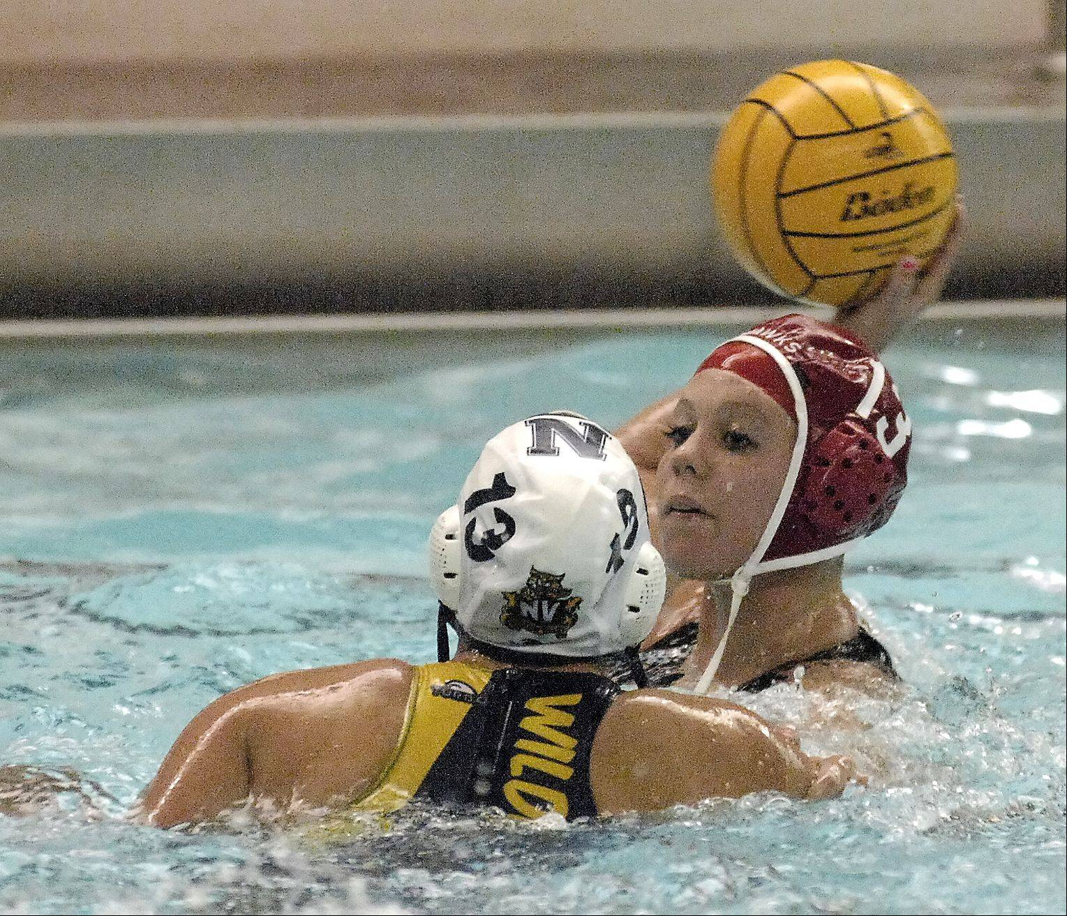 Jenny Doyle of Naperville Central looks to pass the ball around Kristina James of Neuqua Valley during varsity girls water polo at Naperville Central, Thursday.