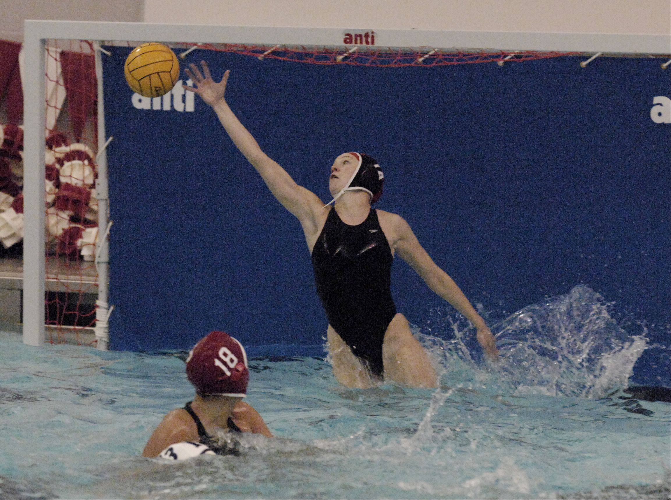 Jessica Fox of Naperville Central works the net during the Redhawks 13-4 win over Neuqua Valley in varsity girls water polo at home, Thursday.