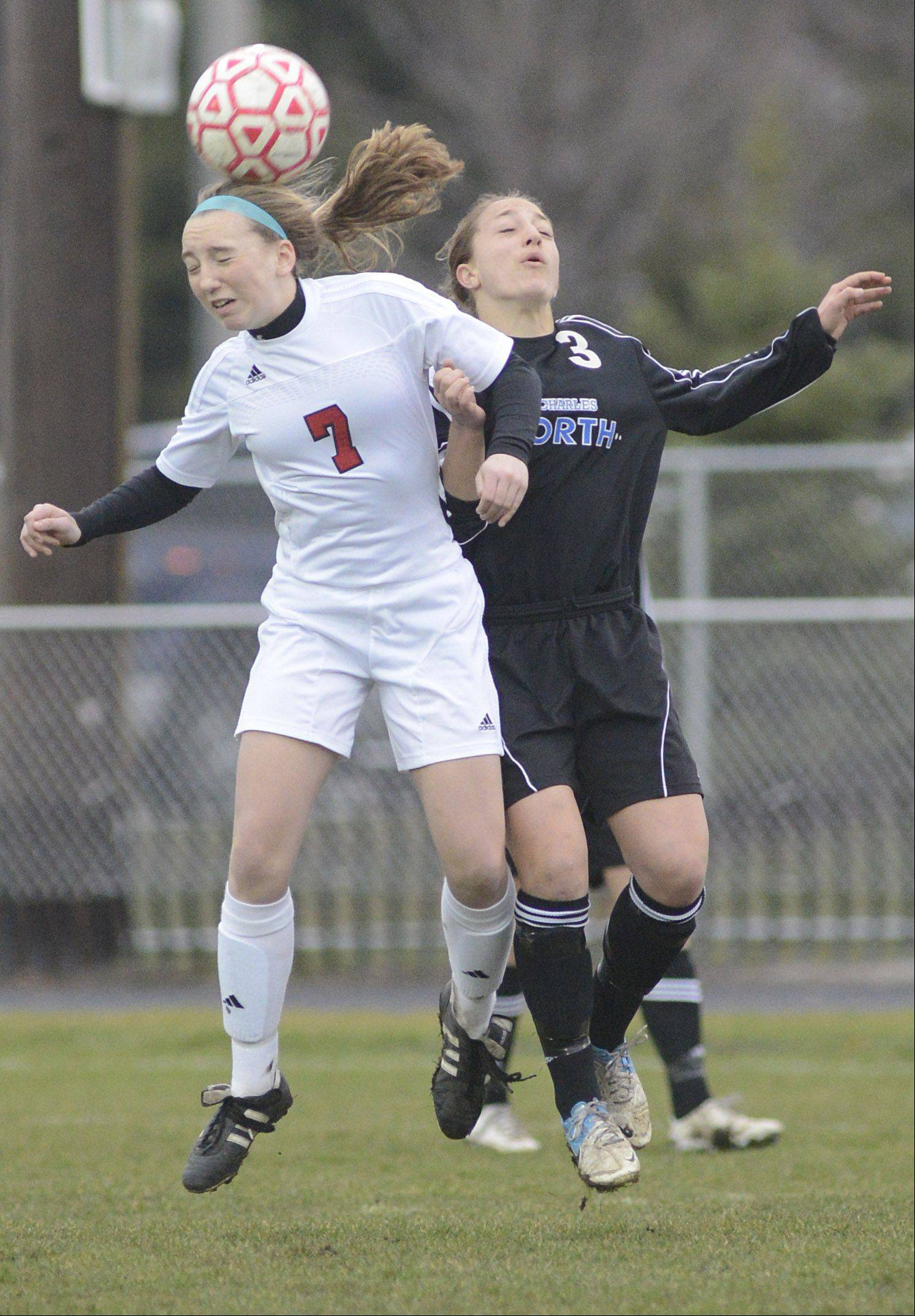 Batavia's Alexis Bryl and St. Charles North's Alex Gage both lead to head the ball in the first half on Thursday, April 11.