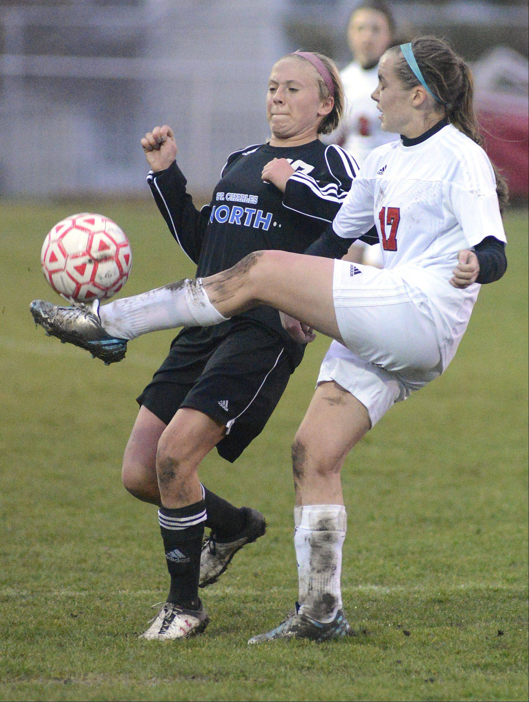 St. Charles North's Kelly Manski and Batavia's Alison Grimm fight for possession for the ball in the first half on Thursday, April 11.