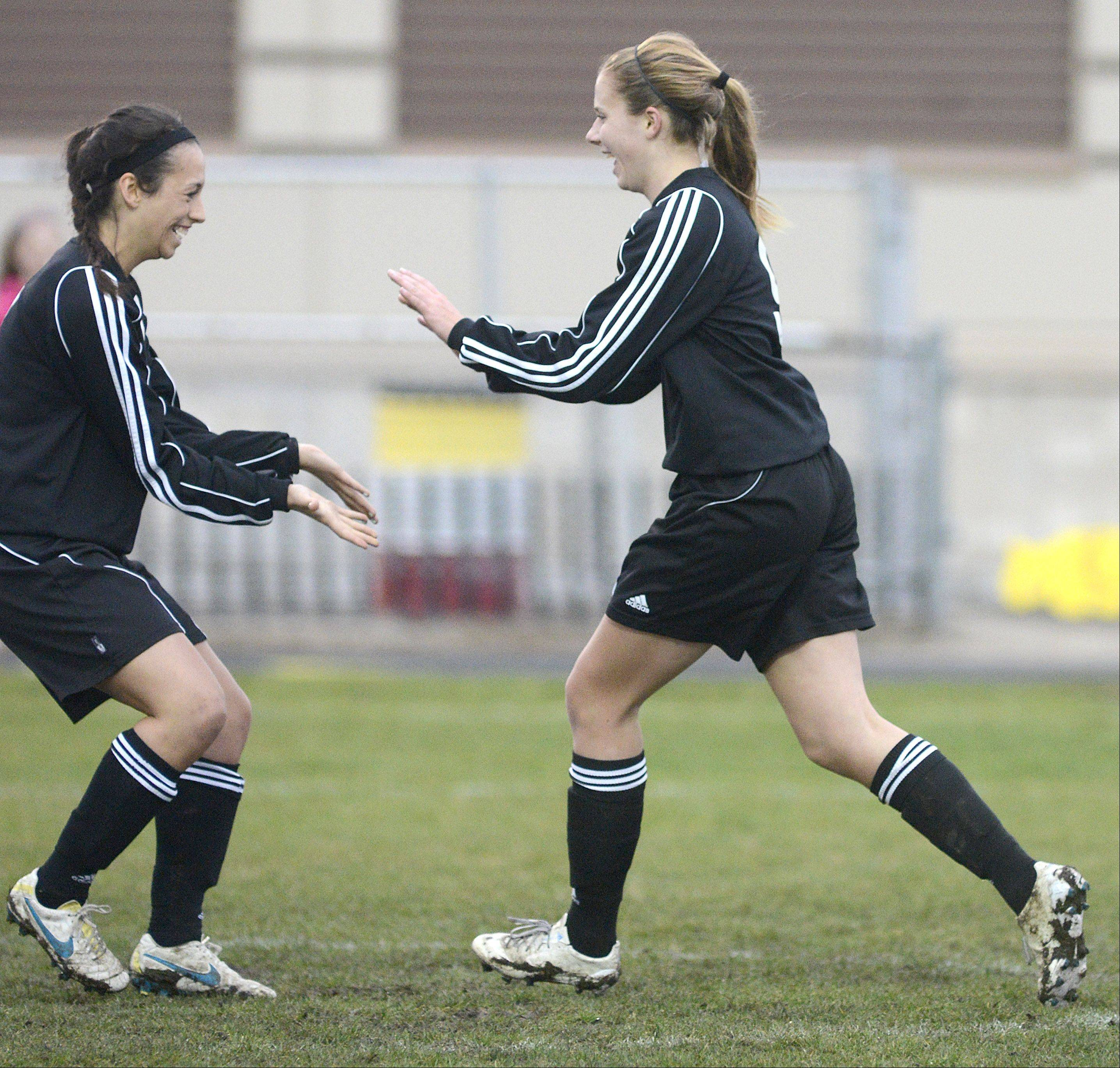 St. Charles North's Ashlyn Walter, left, greets teammate Alyssa Brandt after her goal over Batavia in the first half on Thursday, April 11.