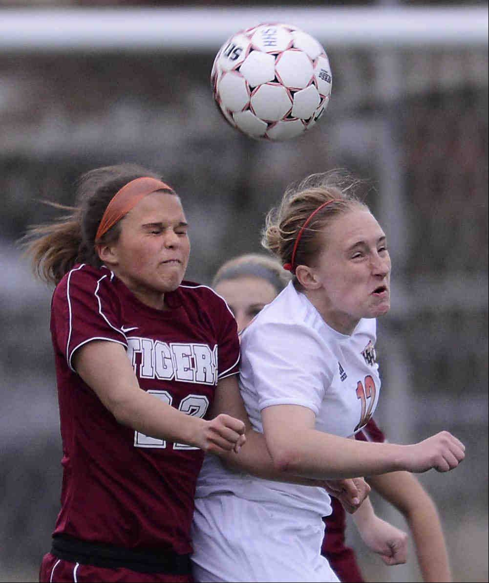 Huntley's Deanna Hecht and Plainfield North's Karsyn Stirrett compete for a header Thursday in the Pepsi Showdown quarterfinal game at Northern Illinois University in DeKalb.