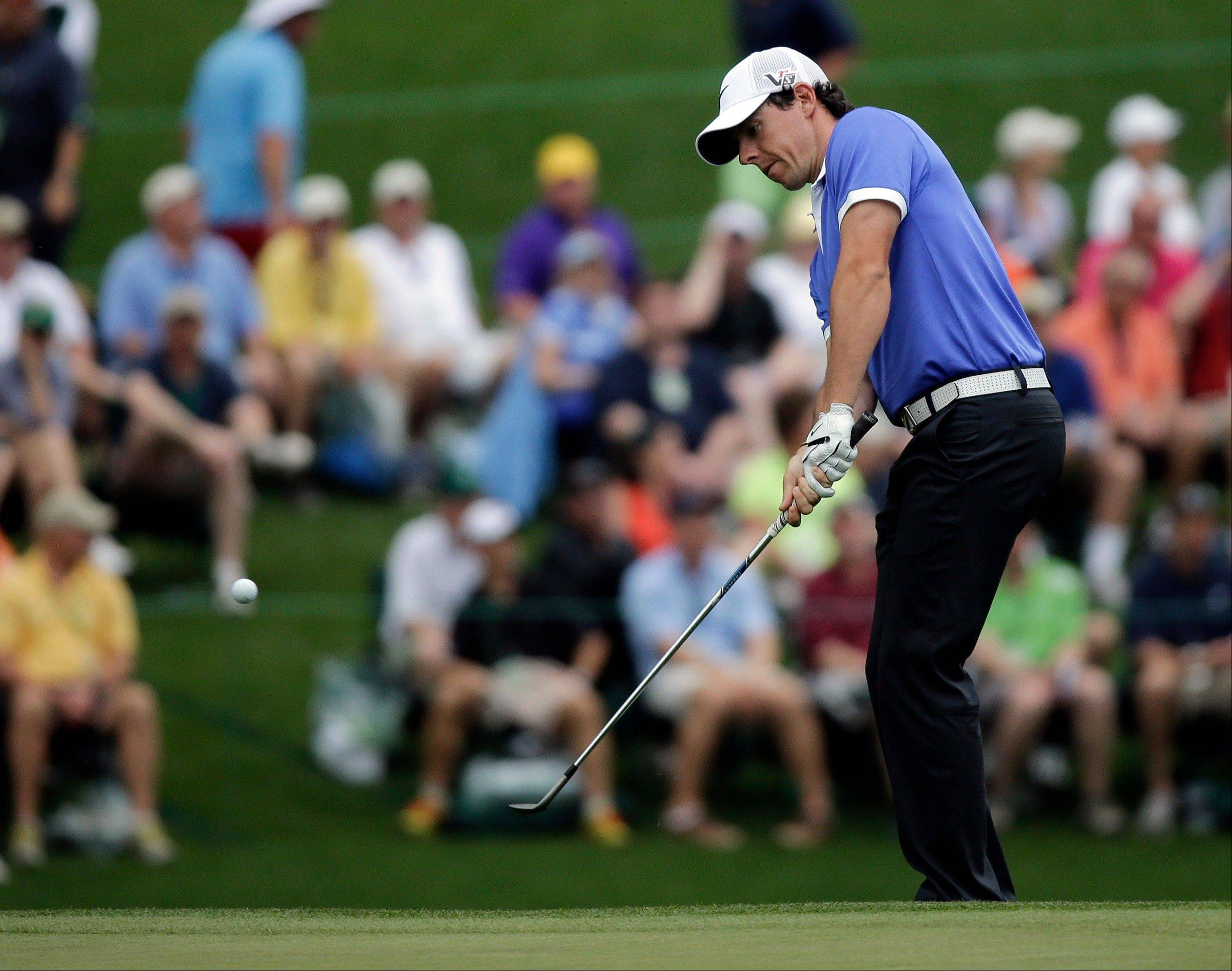 Rory McIlroy, of Northern Ireland, chips to the 15th green during the first round of the Masters golf tournament Thursday, April 11, 2013, in Augusta, Ga.