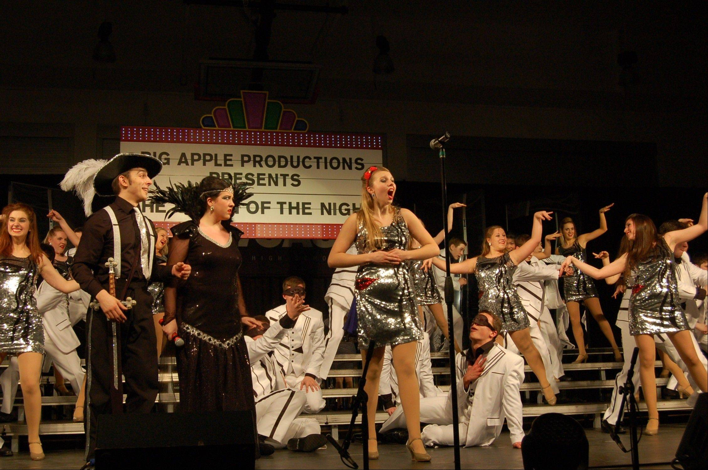 "The Expressions Show Choir performs ""Queen of the Night."" Pictured, from left in the foreground, are Joe Cavaiani, Alyssa Gillespie and Jessica Wolf."