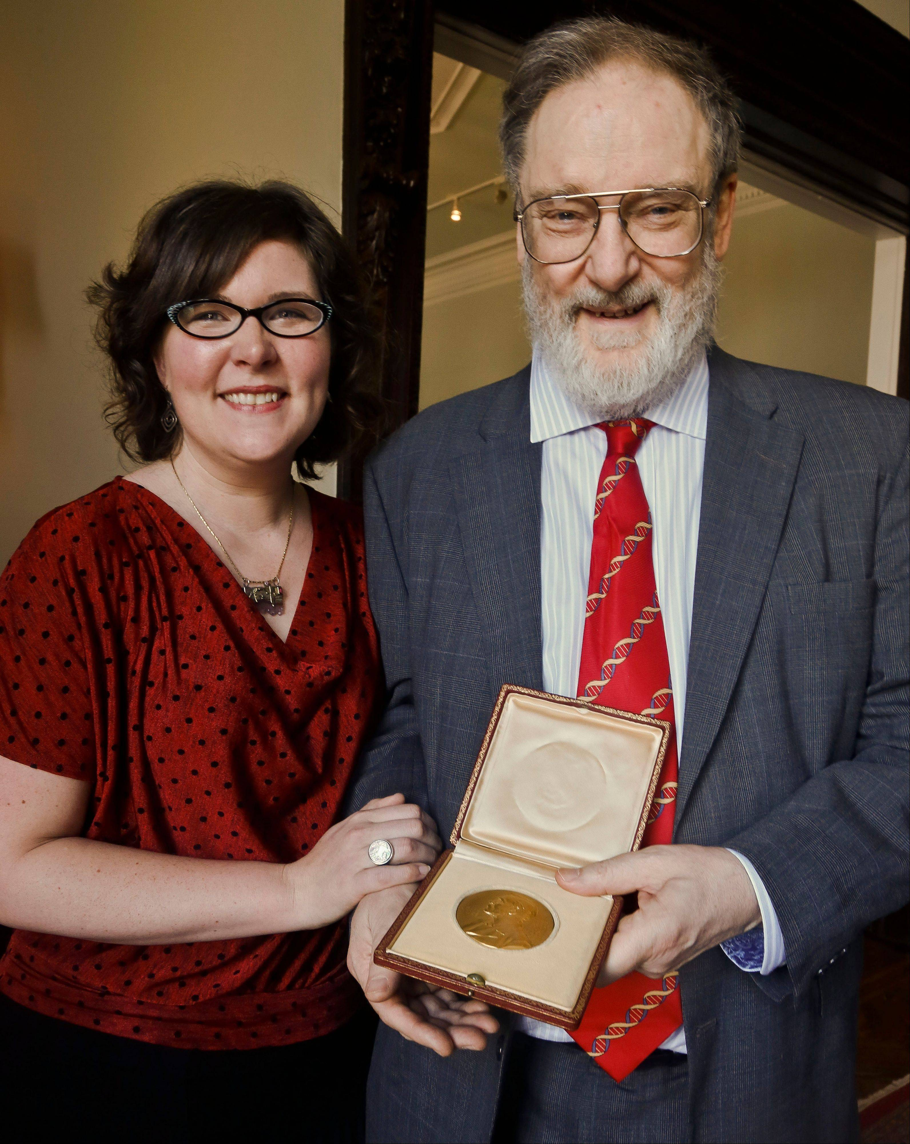Kendra Crick poses with her father Michael Crick as he holds the 1962 Nobel Prize for Medicine awarded to his father, molecular biologist Dr. Francis Harry Compton Crick. Francis Crick helped decipher the DNA molecule.