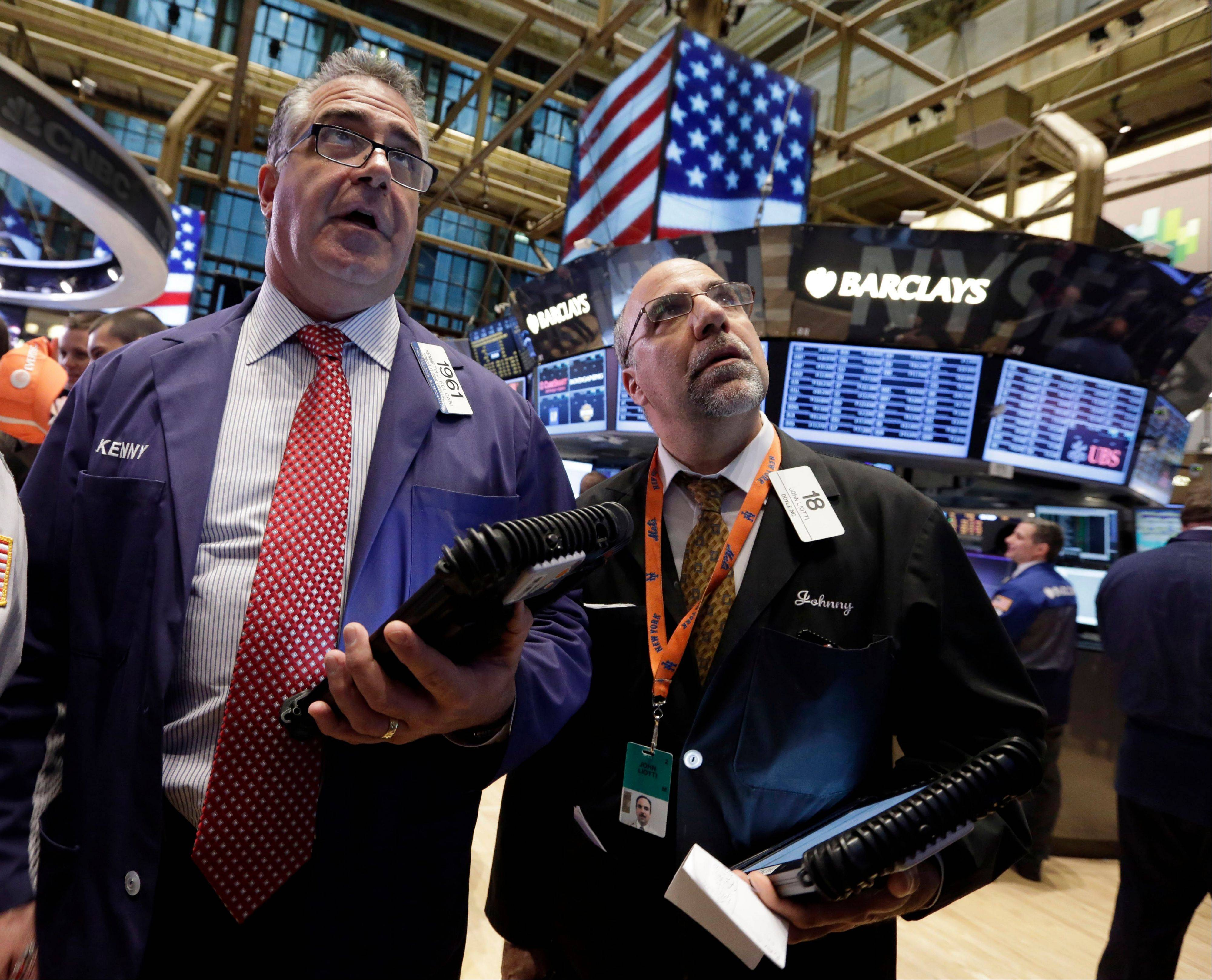 Traders Kenneth Polcari, left, and John Liotti work Friday on the floor of the New York Stock Exchange.