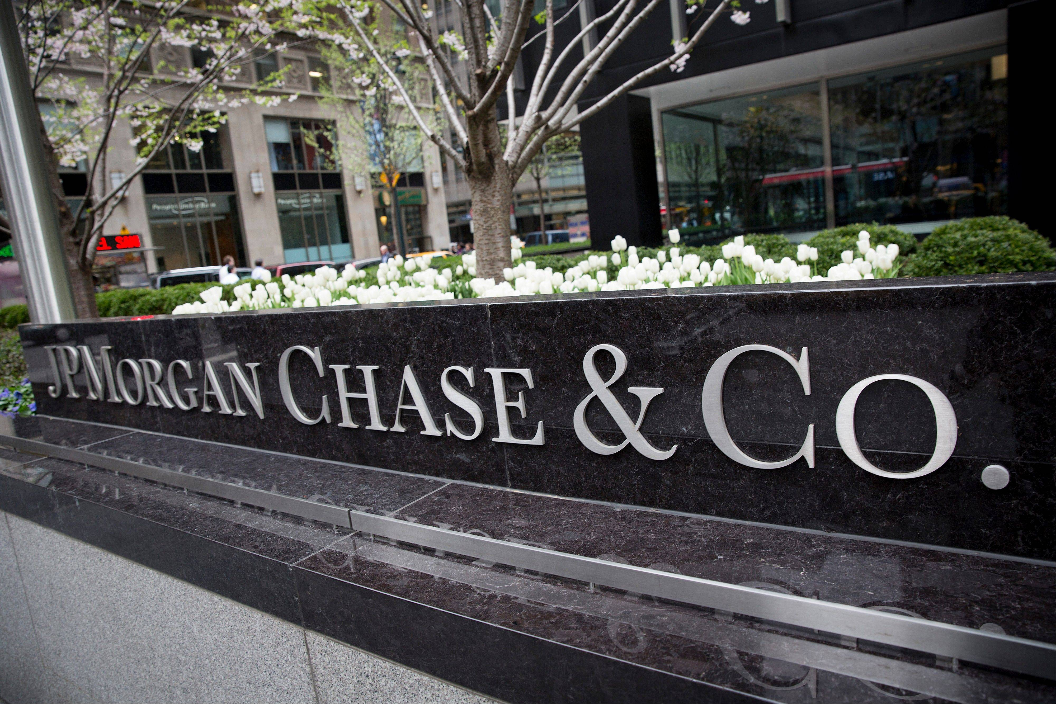 JPMorgan Chase, the country�s biggest bank by assets, says its first-quarter earnings soared, even as revenue fell slightly.