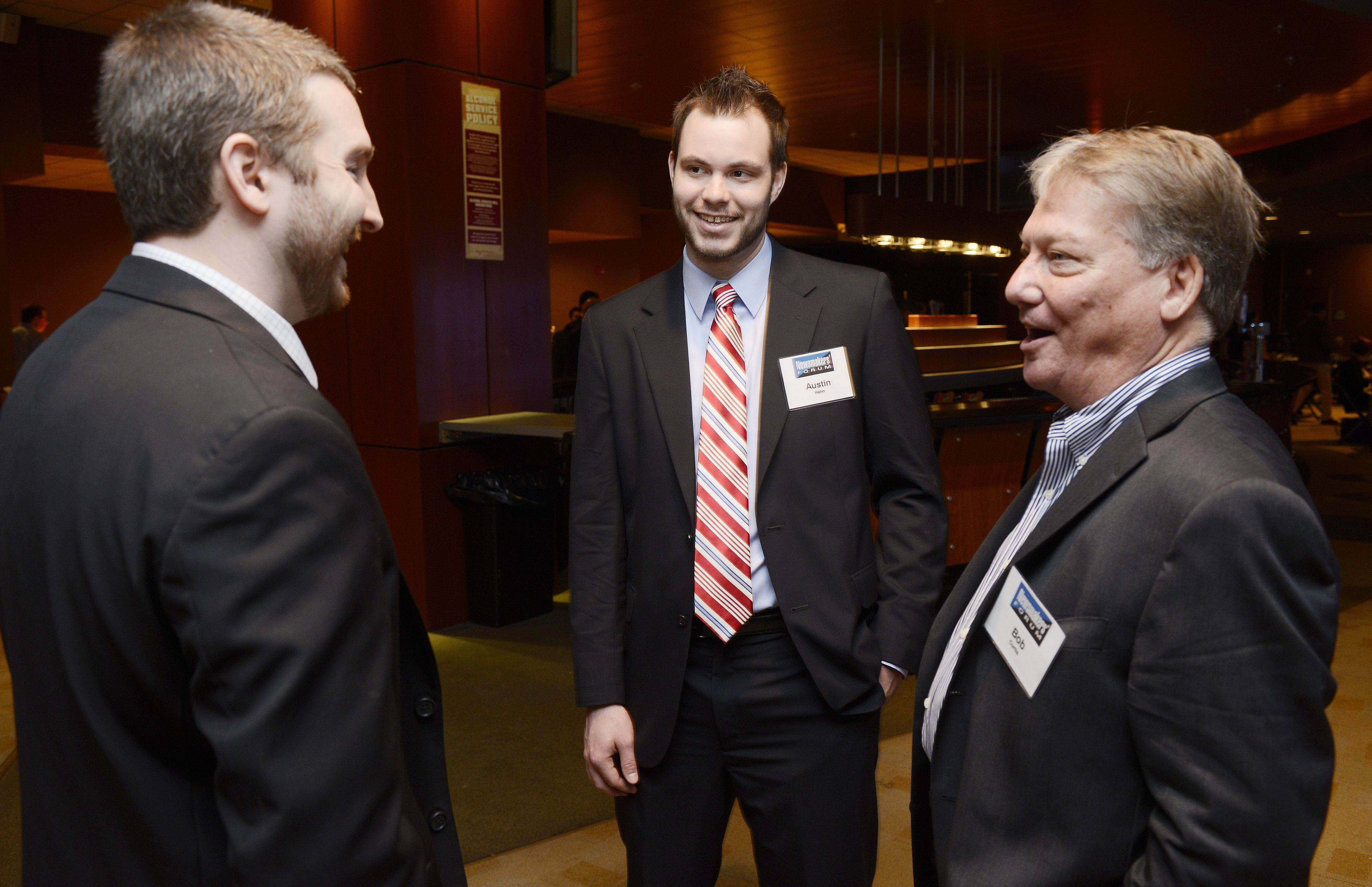 Greg Sprott of the Chicago Wolves, left, and Austin Hahn of Northwestern University Sports Administration chat with retired banker Bob Curtis of Barrington during a Newsmakers Forum on the business of sports, held at the Sears Centre in Hoffman Estates.