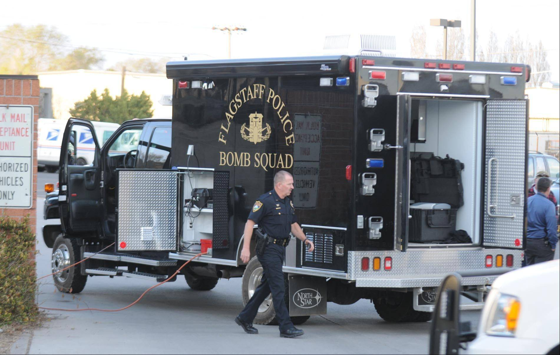 Flagstaff, Ariz., police respond Thursday to a bomb threat at the Flagstaff Post Office on Postal Boulevard. (Associated Press)