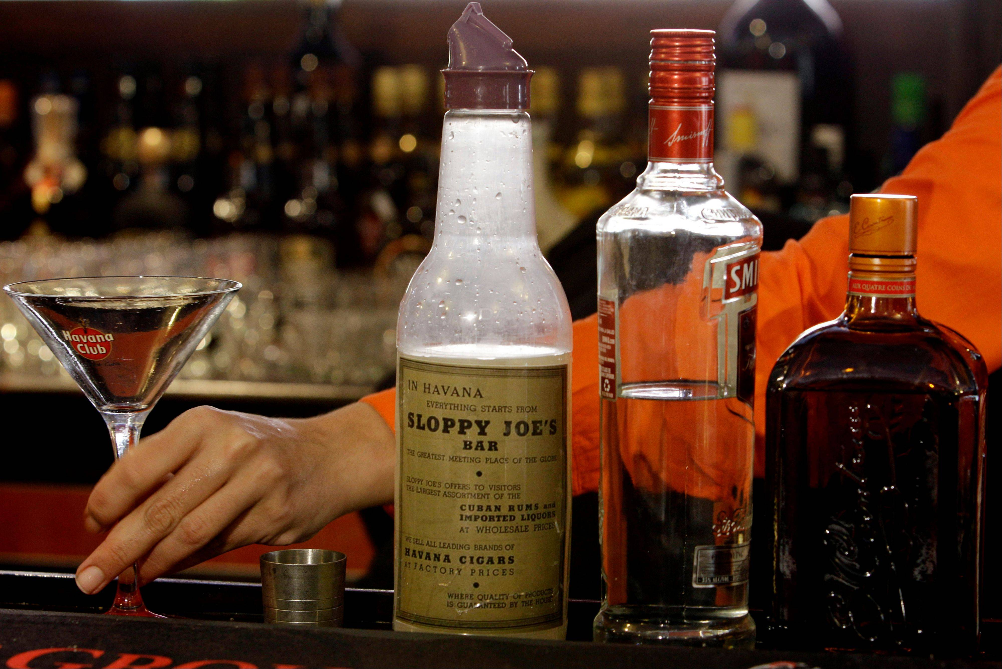 A bartender prepares a drink Friday at Sloppy Joe�s Bar before its reopening in Havana, Cuba.