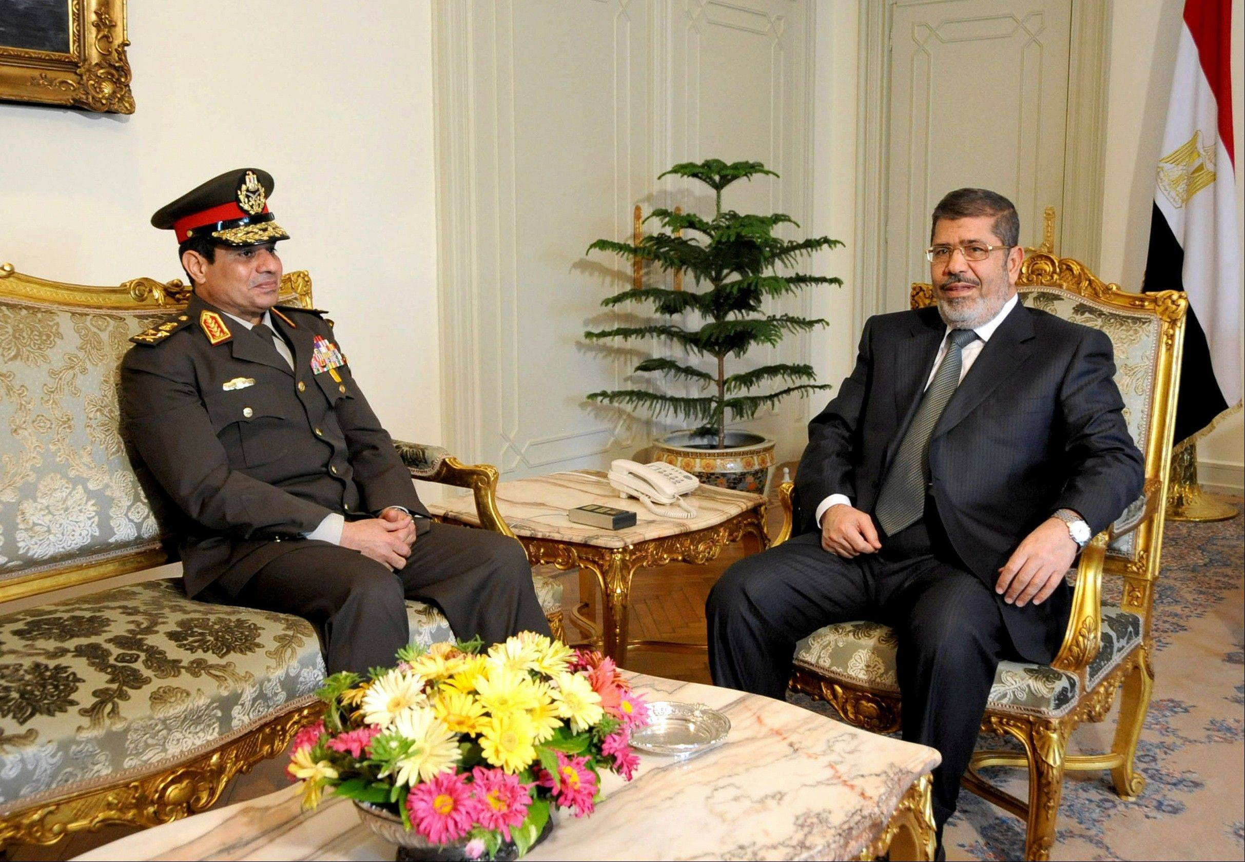 Associated Press/Feb, 21, 2013 Egyptian Minister of Defense, Lt. Gen. Abdel-Fattah el-Sissi, left, meets with Egyptian President Mohammed Morsi at the presidential headquarters in Cairo, Egypt.
