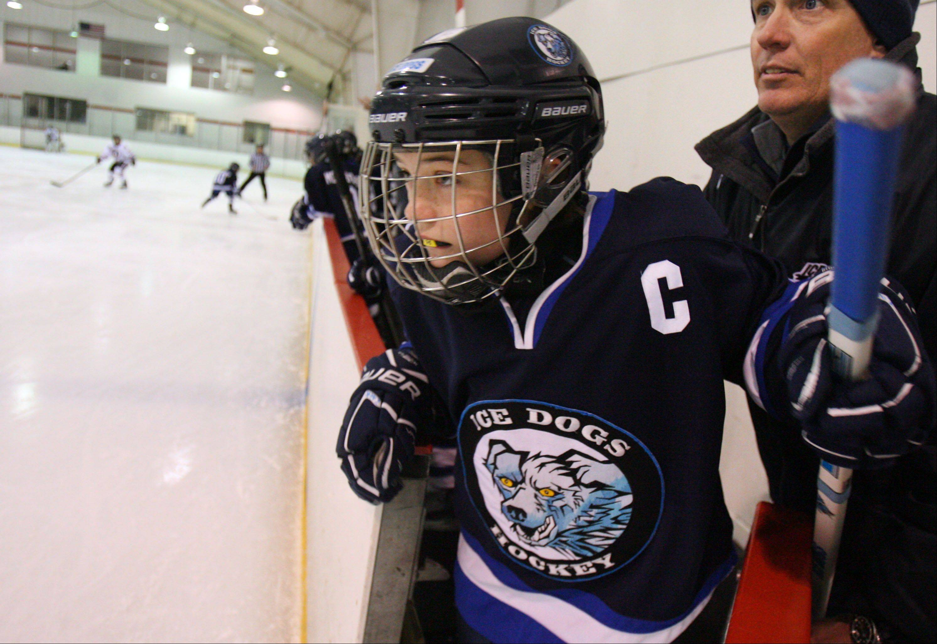 10-year-old Madison Zack gets ready to enter the ice during a recent game in Addison. Madison is the captain of the boys Ice Dogs hockey team.