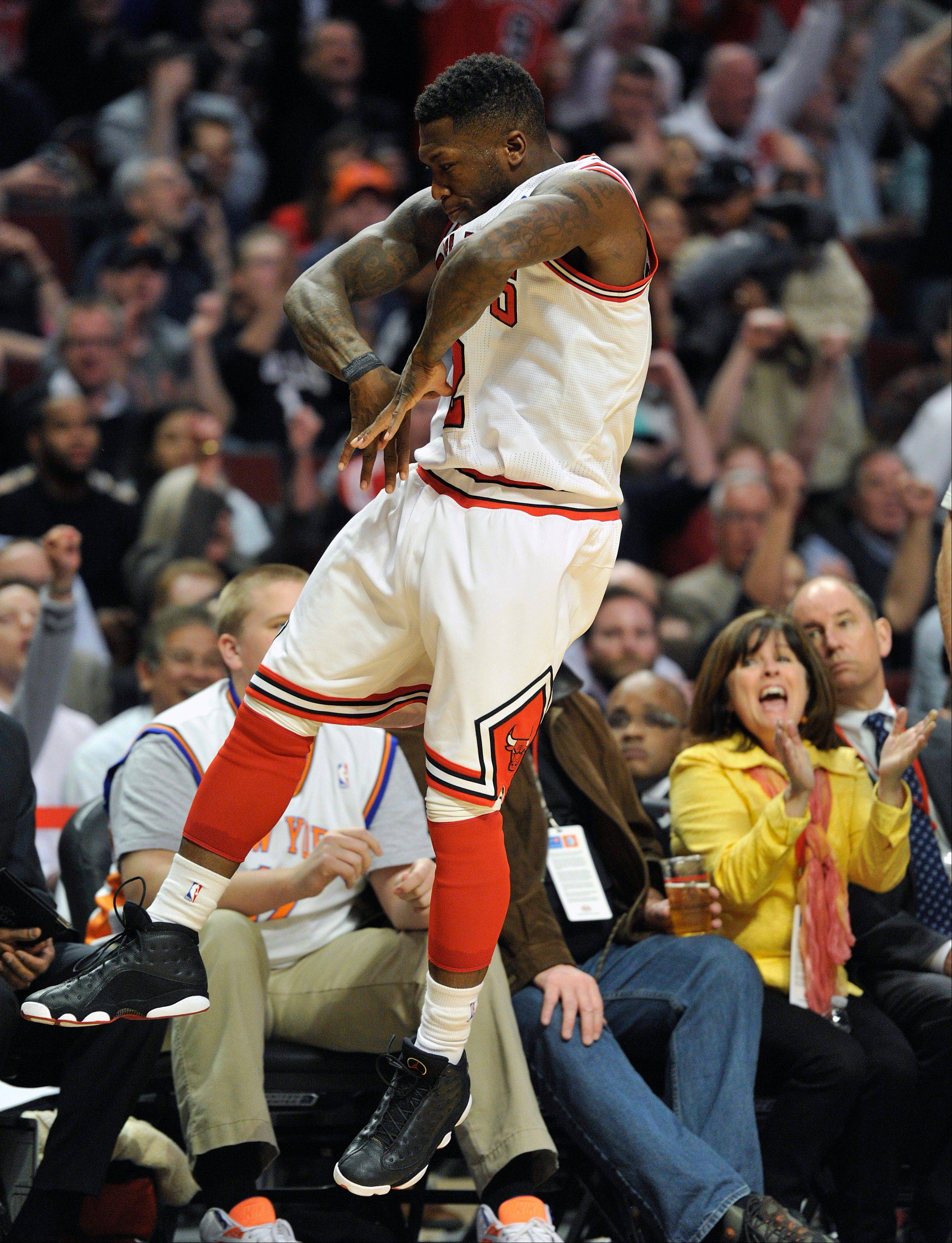 Chicago Bulls' Nate Robinson reacts after a 3-pointer against the New York Knicks during the second half of an NBA basketball game, Thursday, April 11, 2013, in Chicago. The Bulls won 118-111 in overtime. (AP Photo/Jim Prisching)