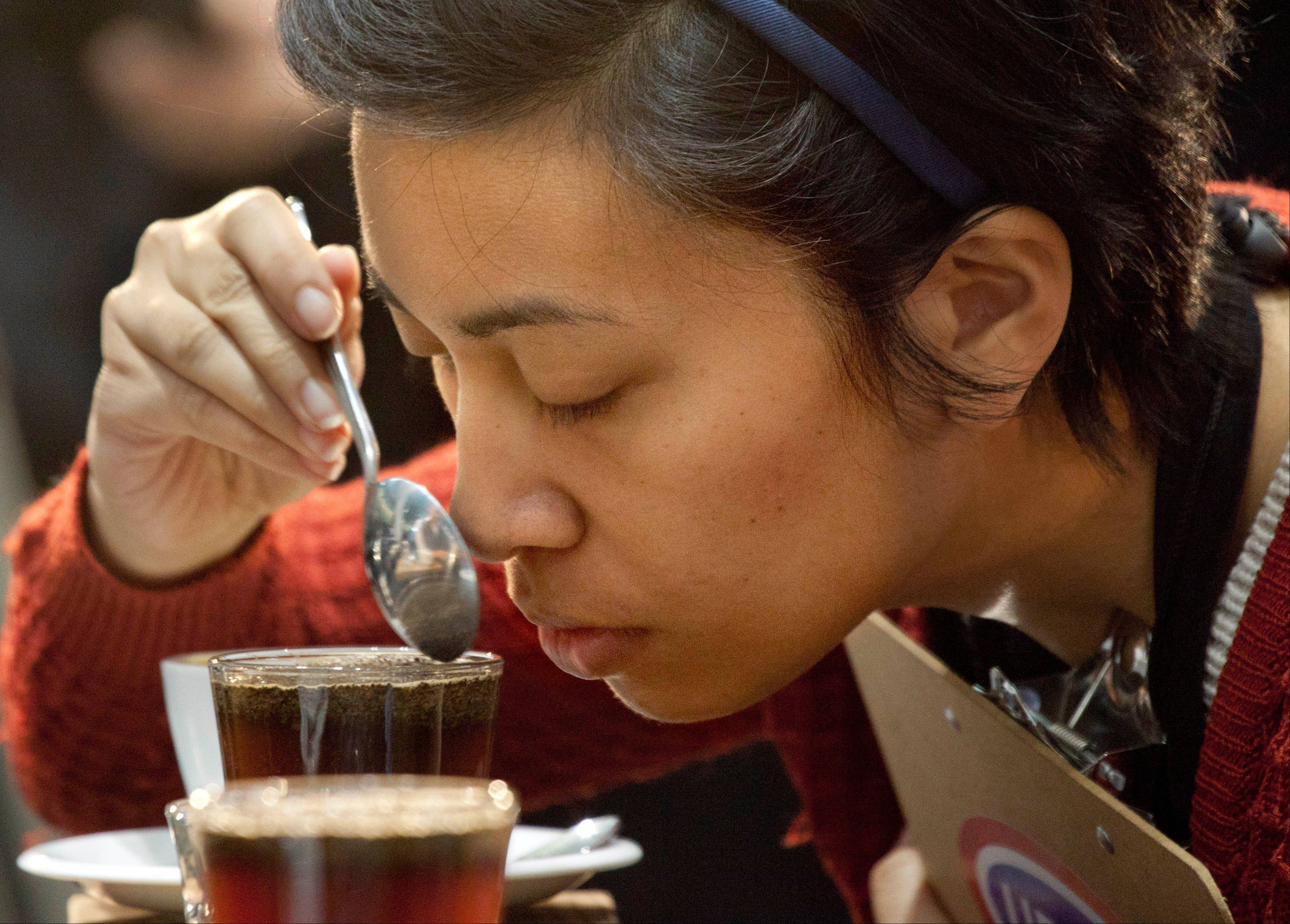 One of the judges tests the aroma of a brewed entry at the annual United States Barista Championship in Boston. Participants have 15 minutes to prepare and serve four espressos, four cappuccinos and four signature beverages, as they compete for a chance to go to the world championship in Melbourne, Australia.