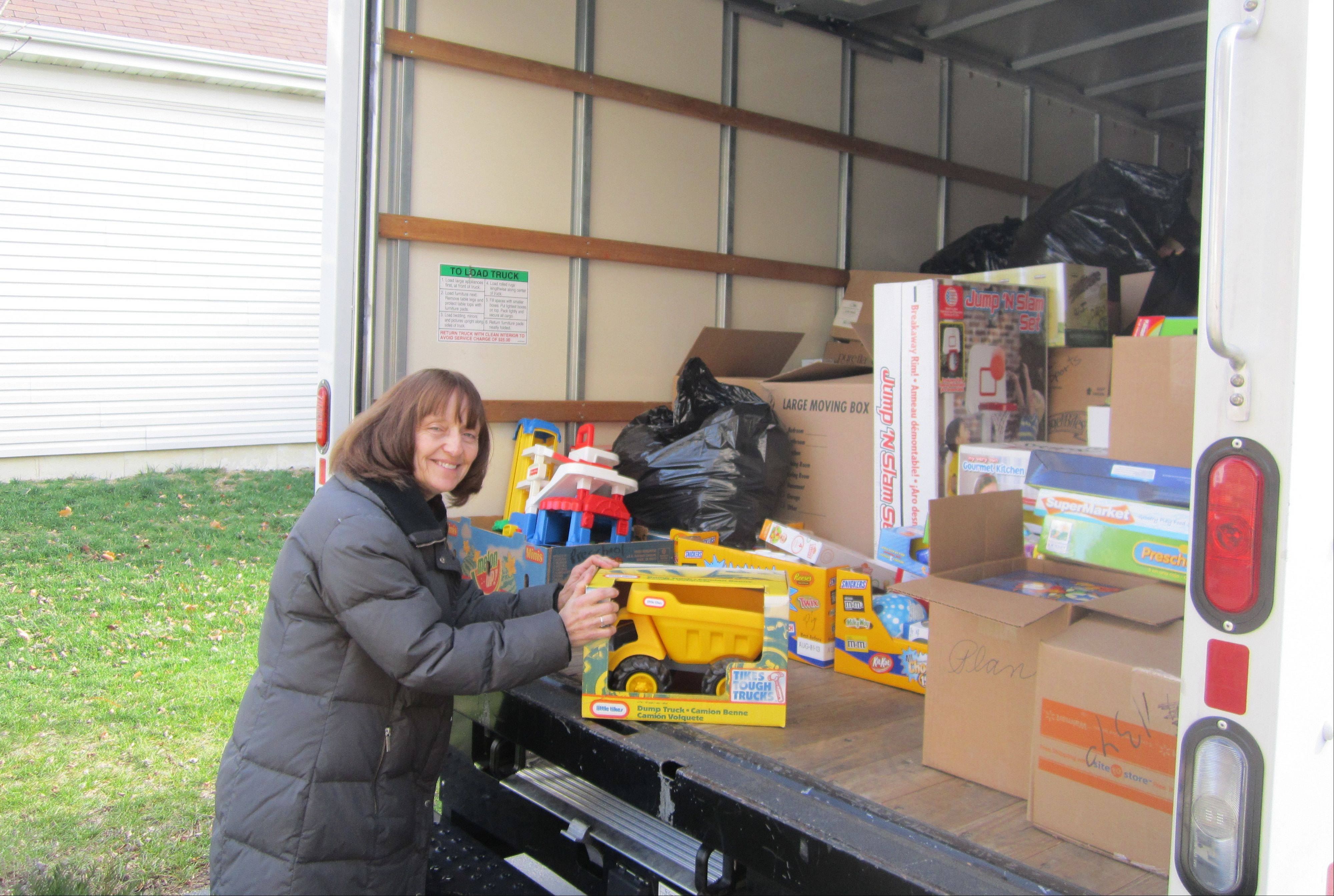 Wen Marcec of Geneva and her husband, Jerry, drove a truckload of toys to Kentucky as part of a Make A Difference Day project in fall 2012. Marcec recently was recognized for her efforts and will receive a $10,000 grant and a trip to Washington, D.C., for a ceremony featuring actor Tony Danza.