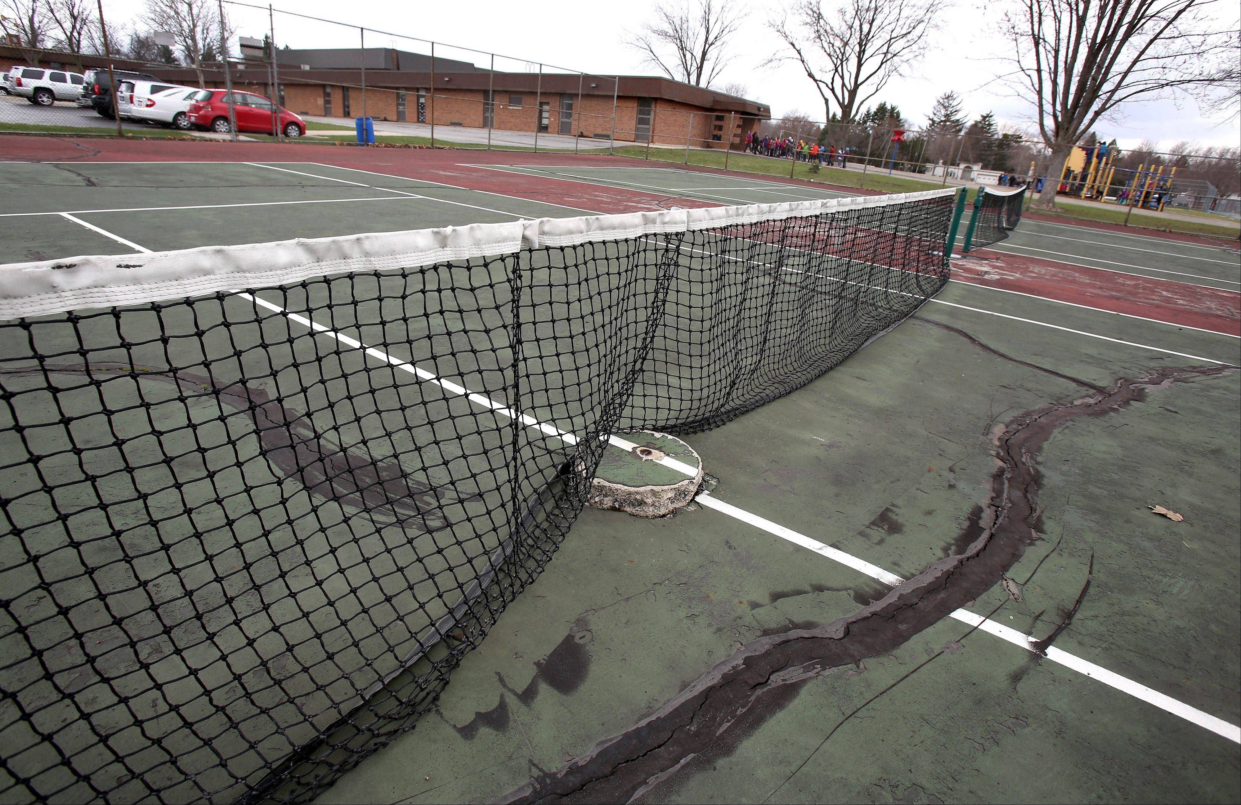 Parents are asking for the two tennis courts outside Pleasant Lane Elementary School in Lombard to be repaired instead of removed. The courts are on school property, but have been maintained by the Lombard Park District under an informal agreement.