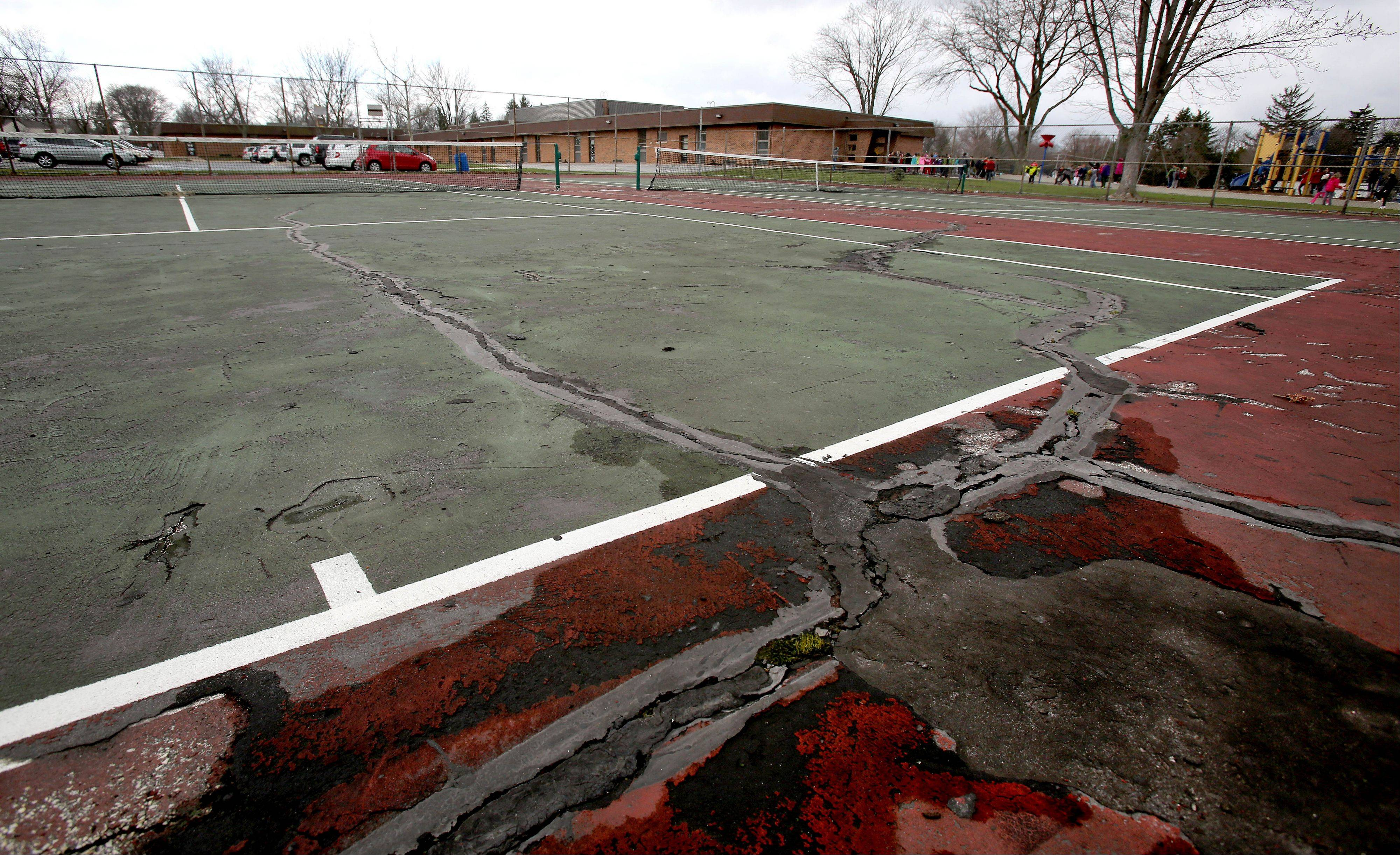 Parents concerned about the poor condition of tennis facilities outside Pleasant Lane Elementary School in Lombard are asking the Lombard Park District and Lombard Elementary District 44 to repair the two courts.