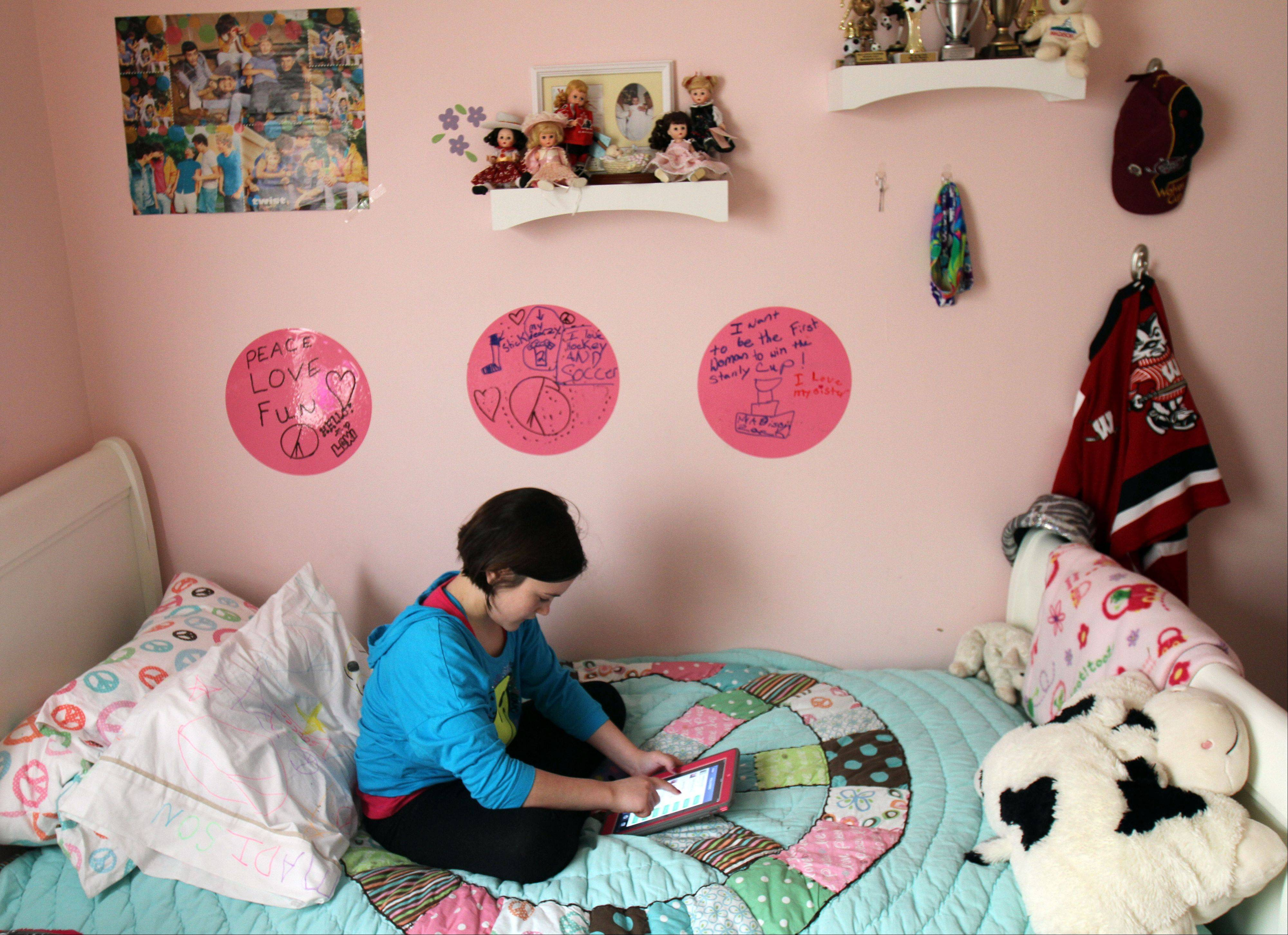 "Madison Zack's room is a mixture of hockey and girl stuff. Next to dolls, you'll find a note that says ""I want to be the first woman to win the Stanley Cup."""