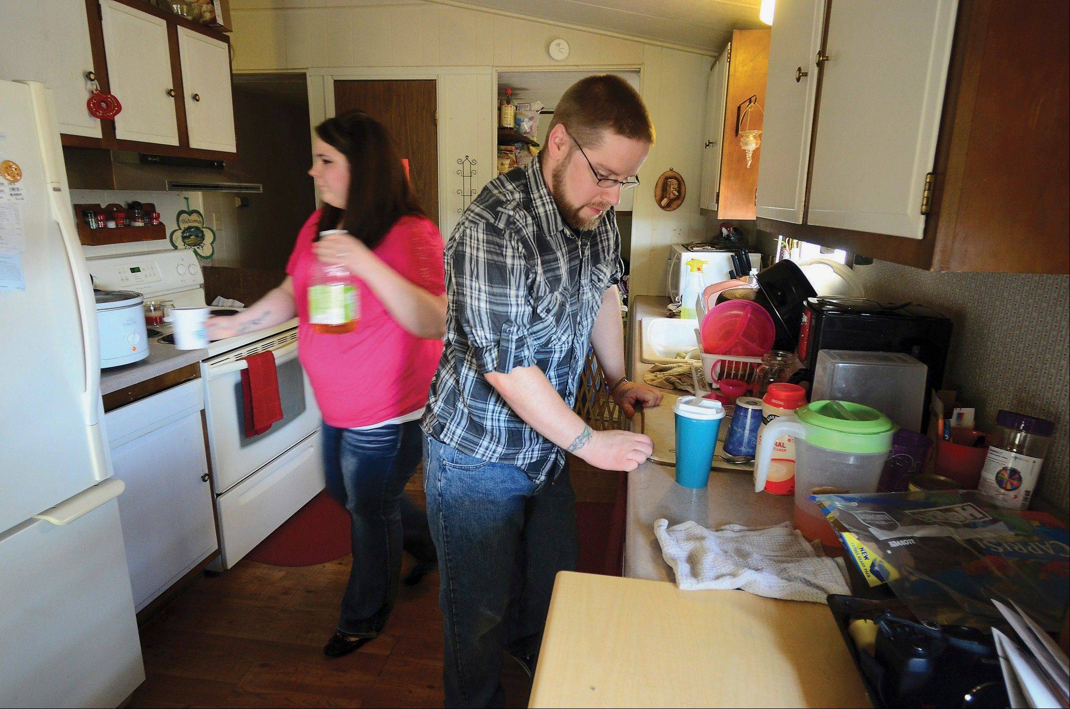 Tom Nelson and his wife, Dacia, in the kitchen of their home in Sterling,