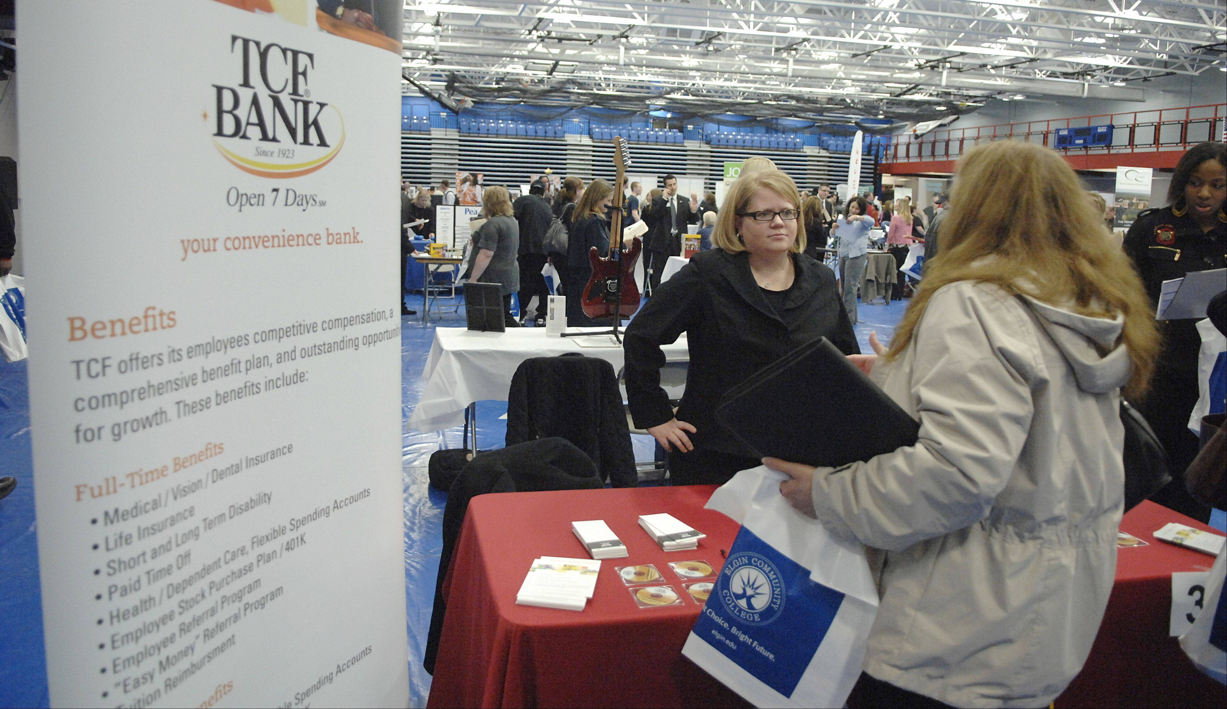 Employment specialist Debbie Sage of TCF Bank talks to interested applicants at a previous Elgin Community College job fair. Job fairs are scheduled for Friday, April 19, at ECC and McHenry County College.