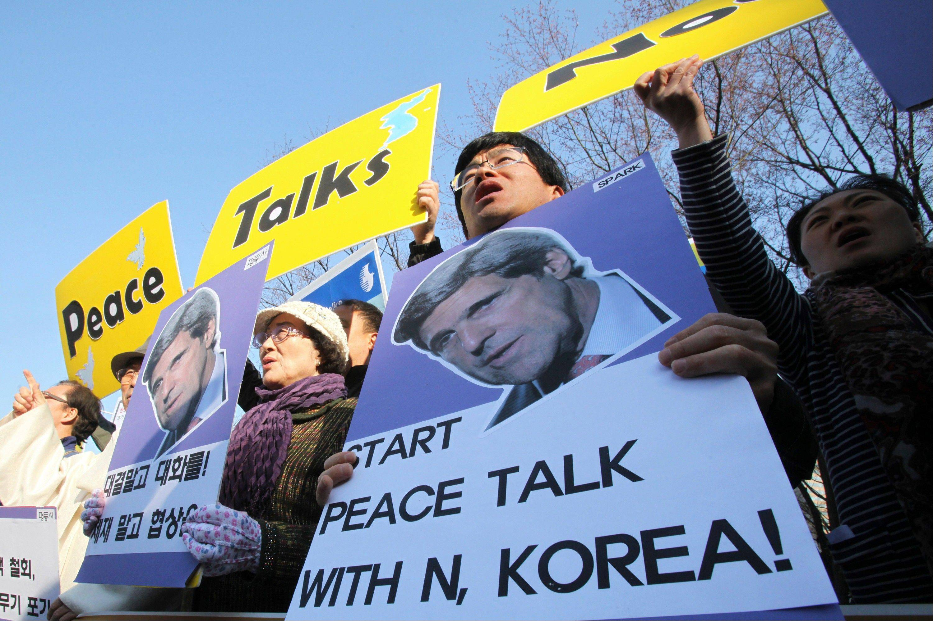 South Korean protesters hold portraits of U.S. Secretary of State John Kerry and shout slogans during a rally to denounce the military exercises and demanding Kerry to go to North Korea for peace in front of the Foreign Ministry in Seoul, South Korea, Friday, April 12, 2013. Kerry arrived in South Korea on Friday on an unusual diplomatic journey, traveling directly into a region bracing for a possible North Korean missile test and risking that his presence alone could spur Pyongyang into another headline-seeking provocation.