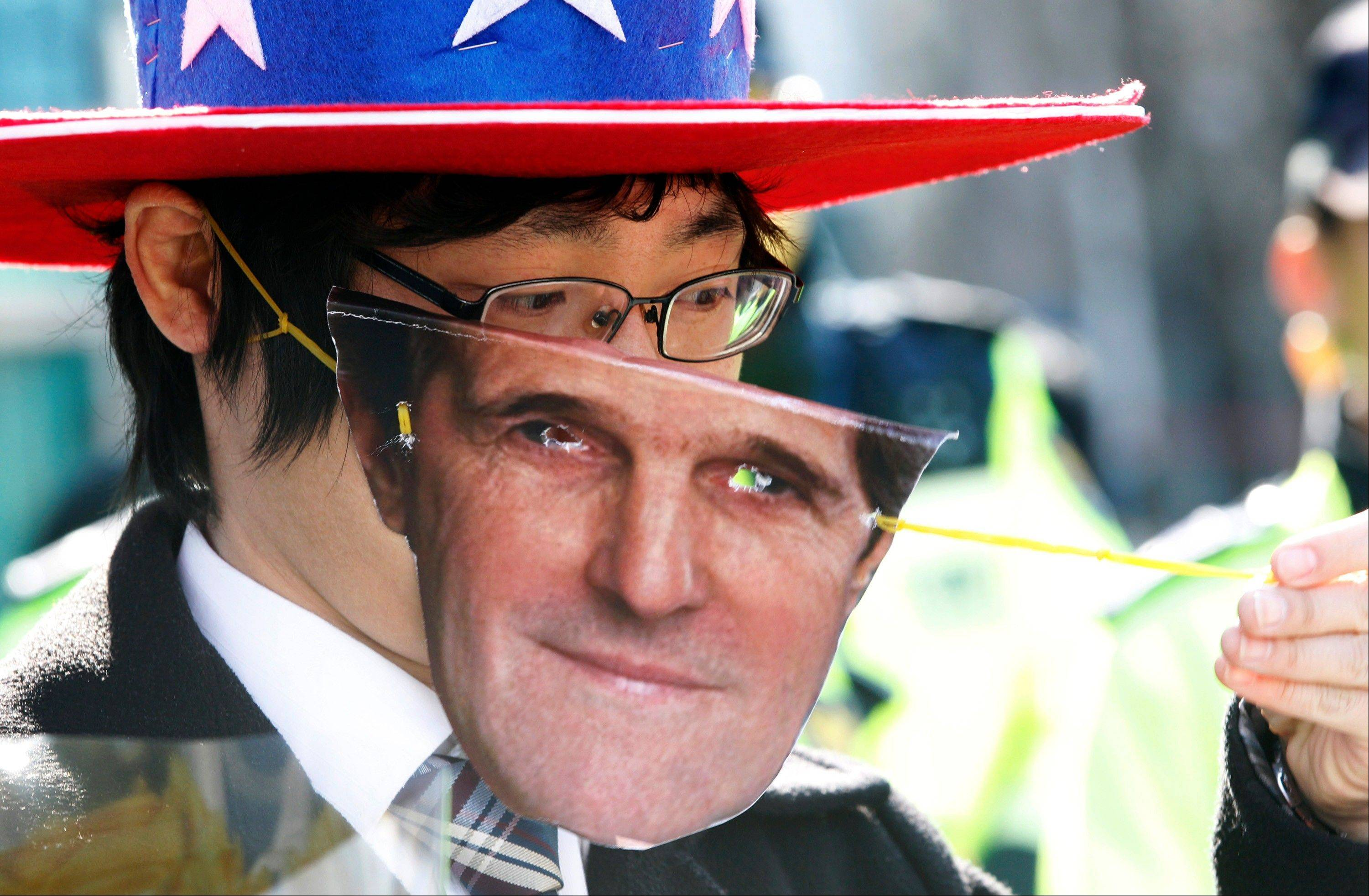 A South Korean protester wears a mask of U.S. Secretary of State John Kerry during a rally to denounce the military exercises and demanding Kerry to go to North Korea for peace in front of the Foreign Ministry in Seoul, South Korea, Friday, April 12, 2013. Kerry arrived in South Korea on Friday on an unusual diplomatic journey, traveling directly into a region bracing for a possible North Korean missile test and risking that his presence alone could spur Pyongyang into another headline-seeking provocation.