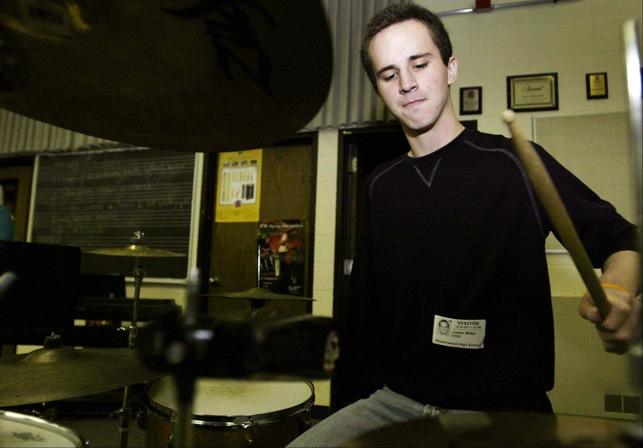 Justin Miller, a 2010 Streamwood graduate, had been playing drums since he was walking. Two years ago, he lost his right arm due to a rare type of cancer, epithelioid sarcoma. He lost his fight to the cancer this week.