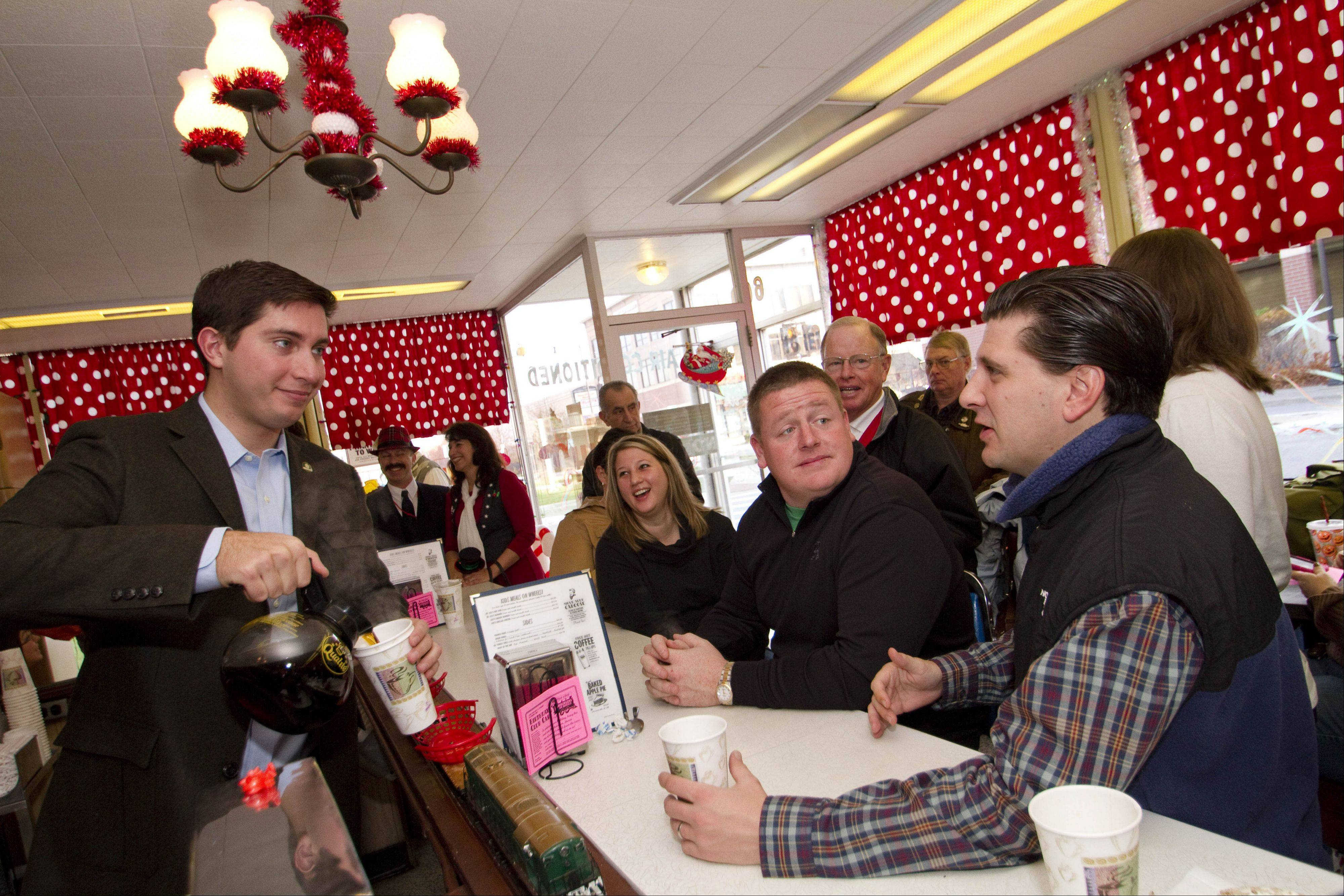 Alderman Matt Bogusz serves coffee to Kristin Meinzer, Patrick McGeean and Matthew Merkle at the Choo Choo Restaurant in Des Plaines as he announces his mayoral candidacy.
