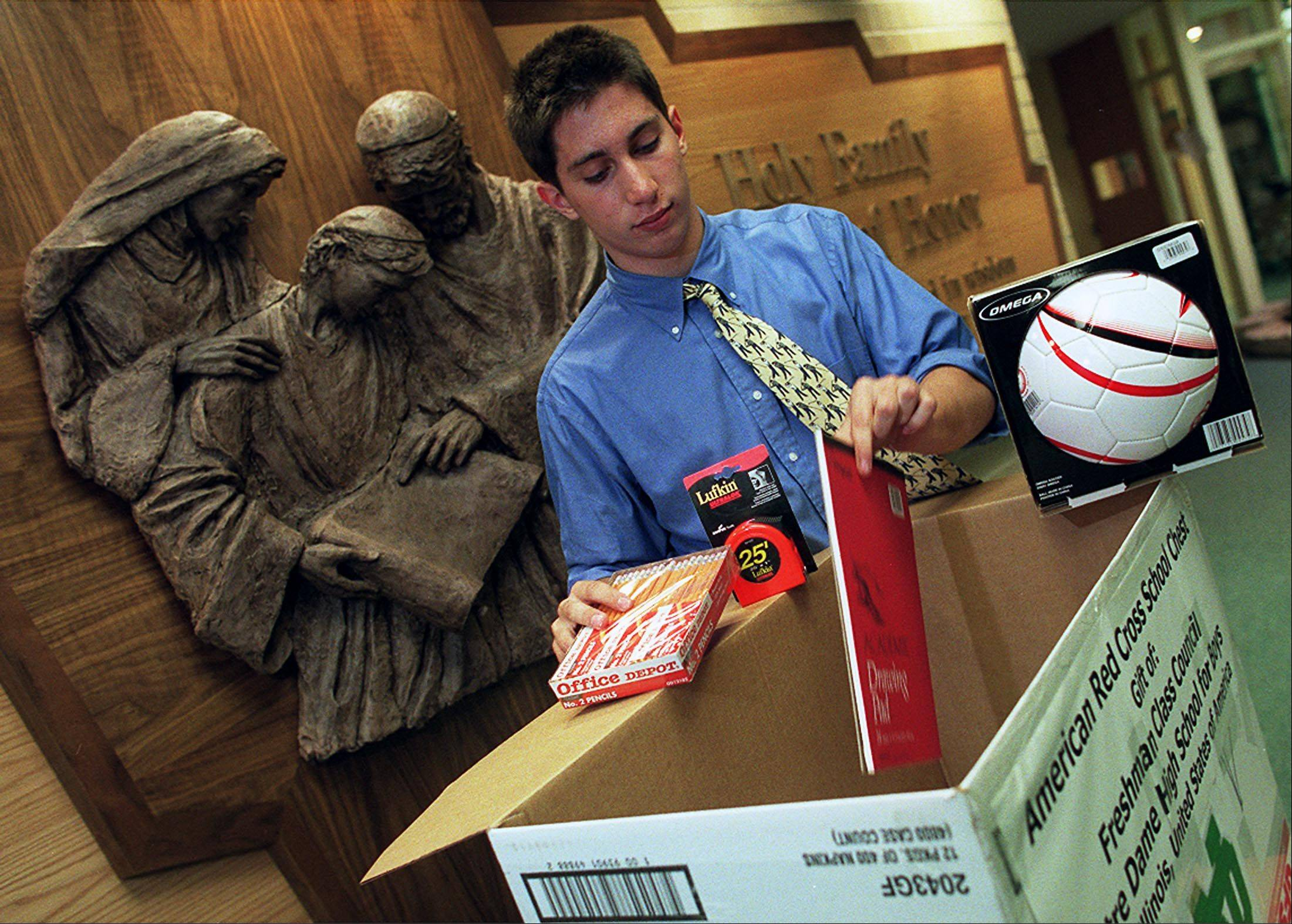 A younger Matt Bogusz, when he was freshman class president at Notre Dame College Prep in Niles, takes stock of supplies he collected for the American Red Cross.