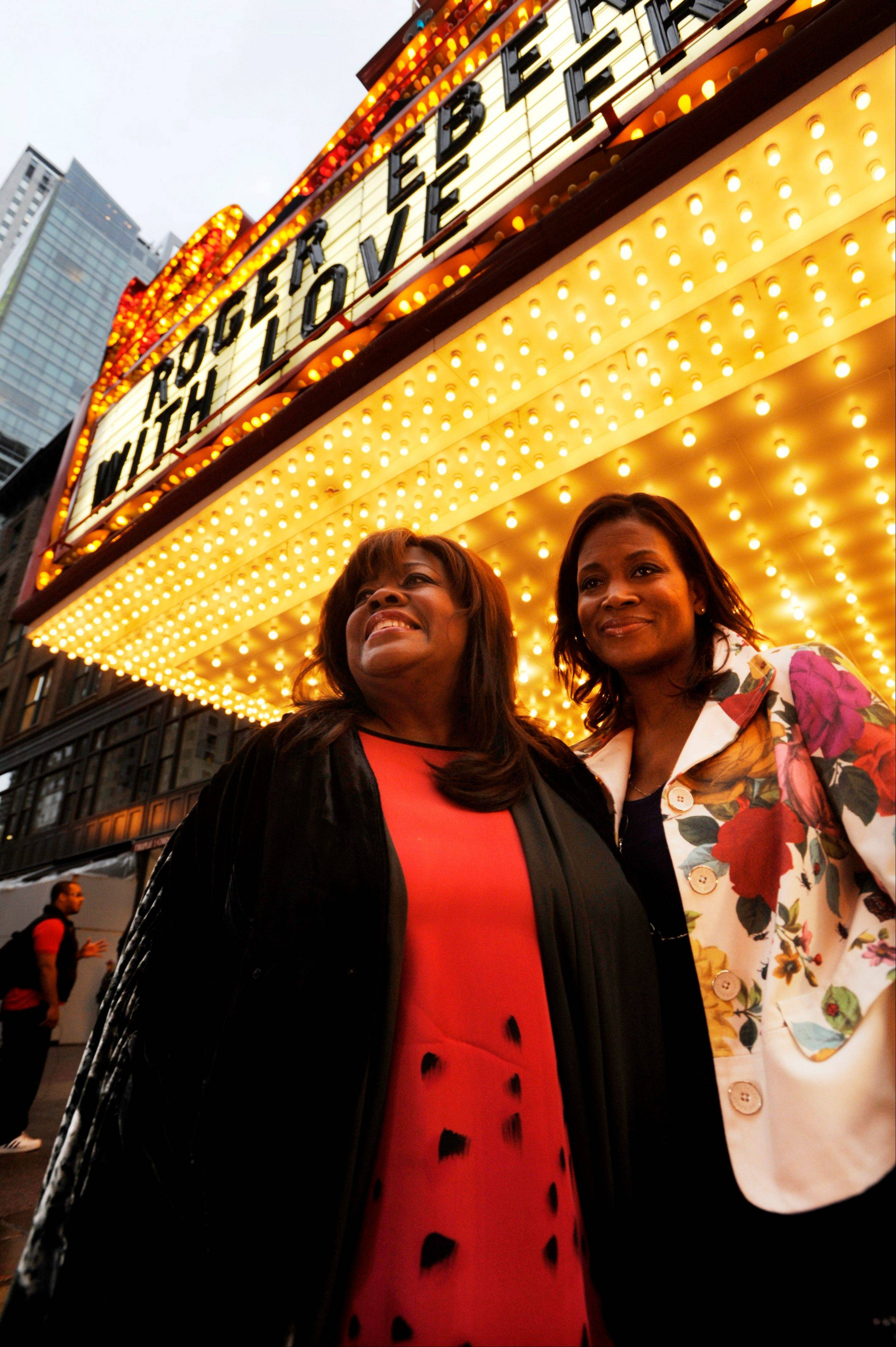 Roger Ebert's wife Chaz Ebert, left, and her daughter Sonia Evans, right, arrive at The Chicago Theater before a memorial for film critic Roger Ebert in Chicago, Thursday, April 11, 2013. The Pulitzer Prize winning critic died last week at the age of 70 after a long battle with cancer.