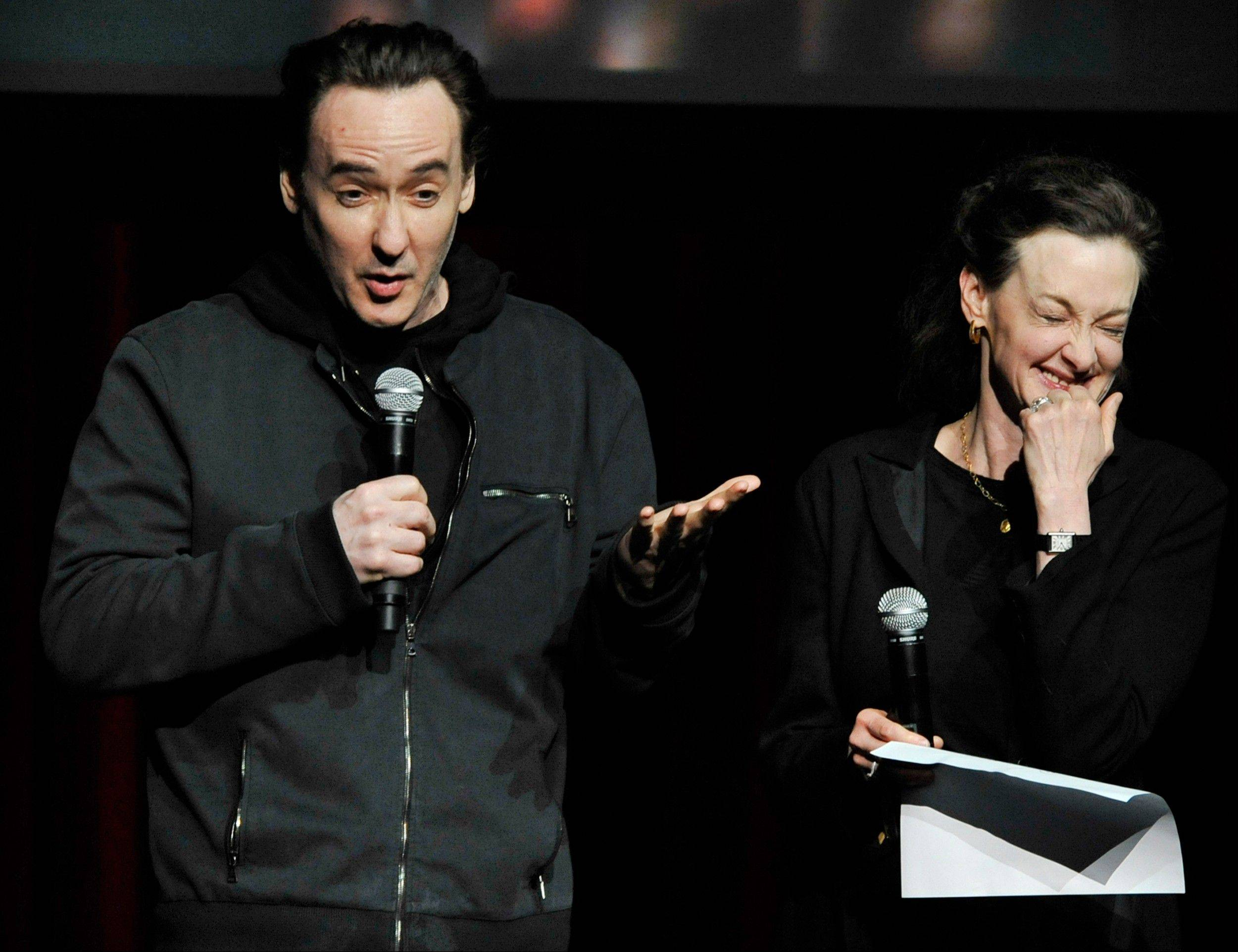 Actors John Cusack left, and Joan Cusack right, talk about Roger Ebert during a memorial for the film critic at The Chicago Theater in Chicago, Thursday, April 11, 2013. The Pulitzer Prize winning critic died last week at the age of 70 after a long battle with cancer.