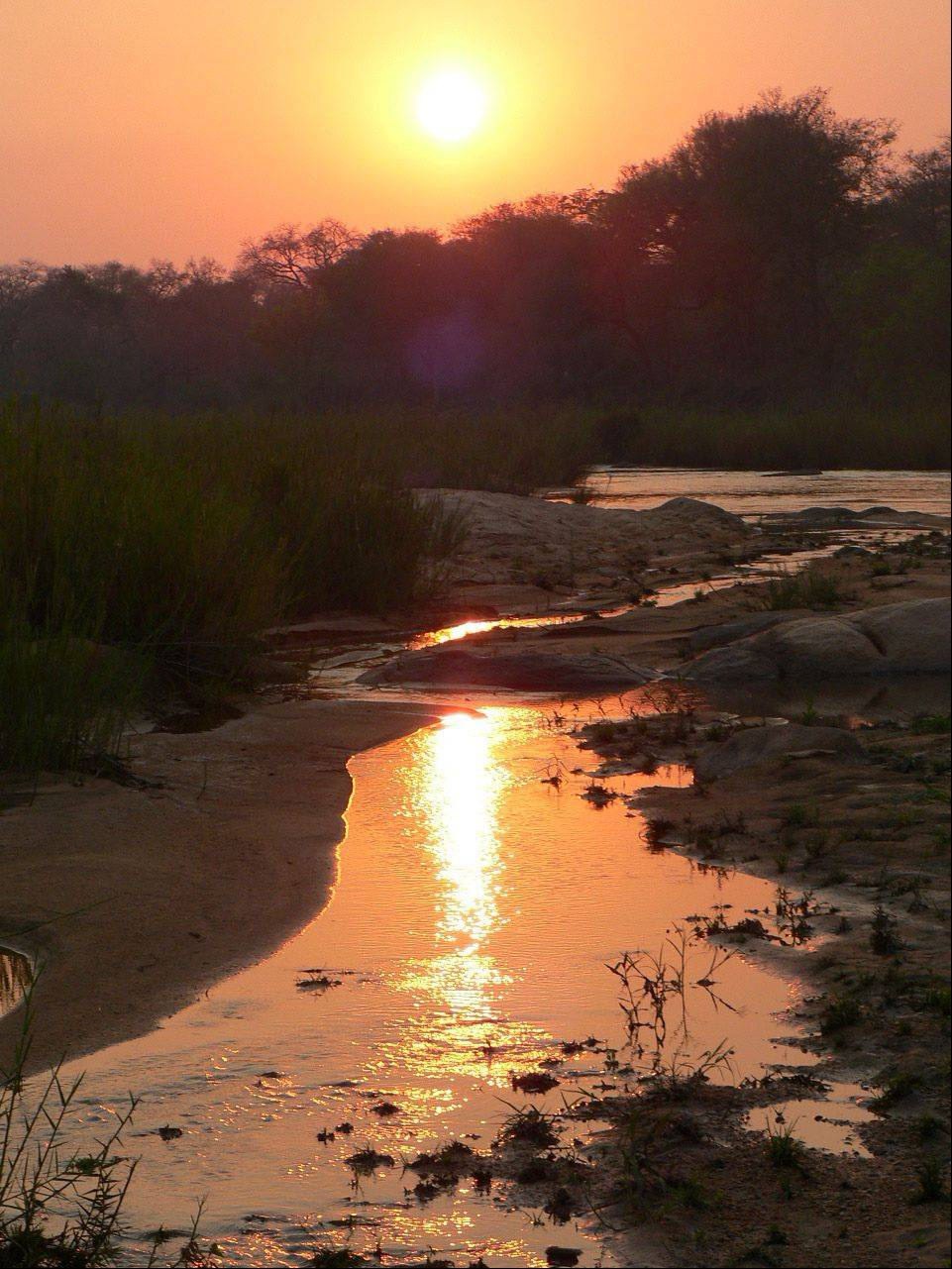 The sun sets on a river that is a hangout for hippopotamuses in South Africa in September, 2012.