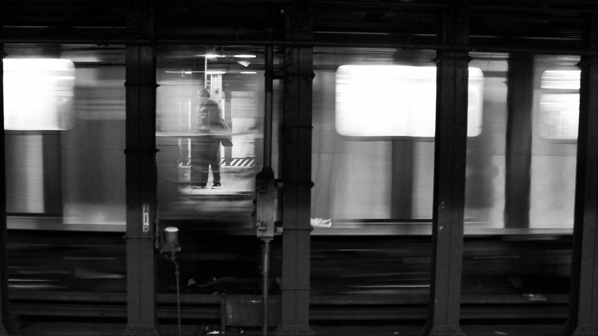 Waiting for the Subway is a B&W image taken at the Times Square stop in New York. I used a slow shutter speed to capture the motion and multiple frames were taken to capture the waiting passenger in between the blur of the cars.