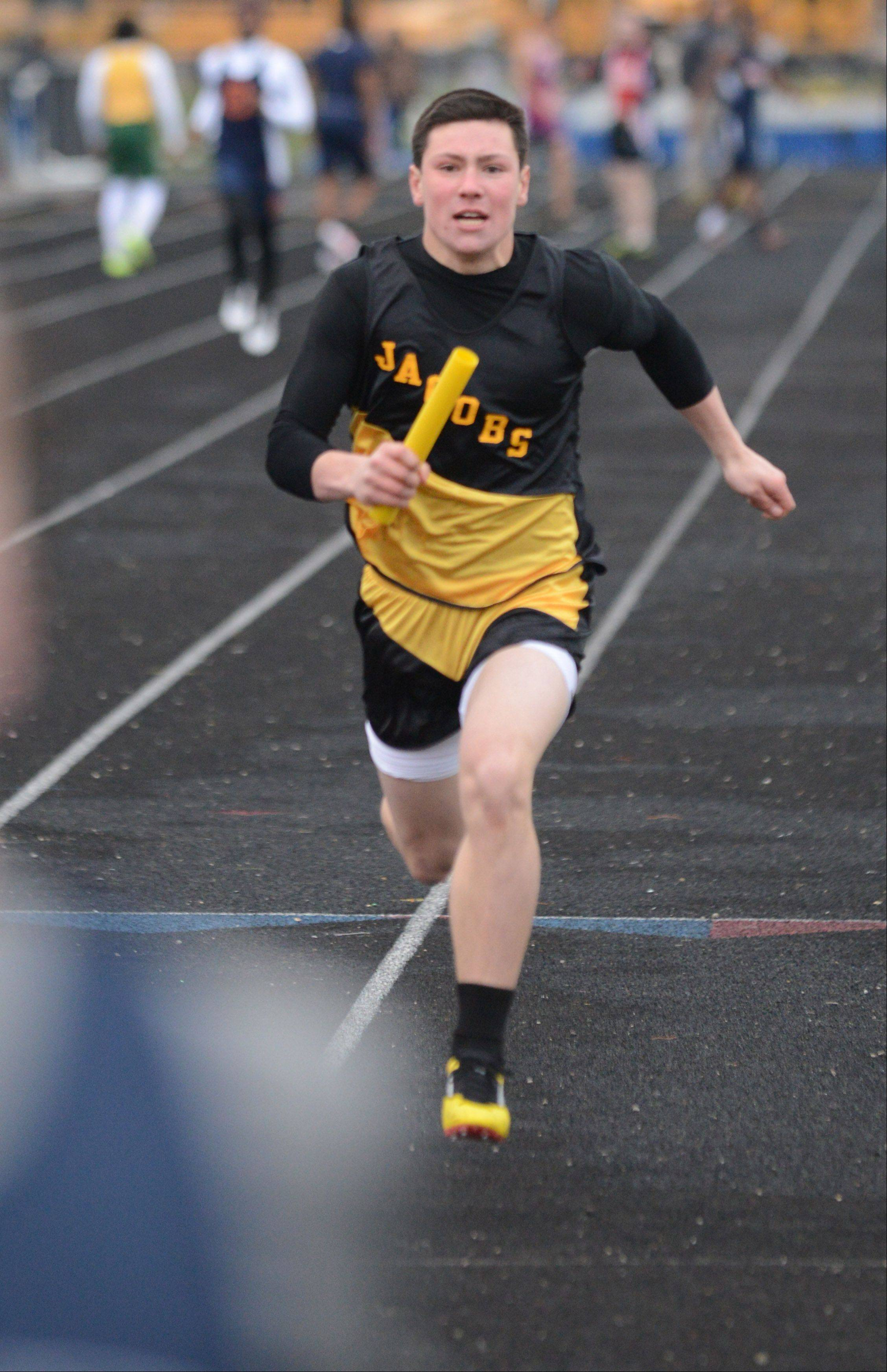 Josh Narvecz of Jacobs makes his way to the line during the Gus Scott track meet at Naperville North on Friday. He was in the 4x800 relay.