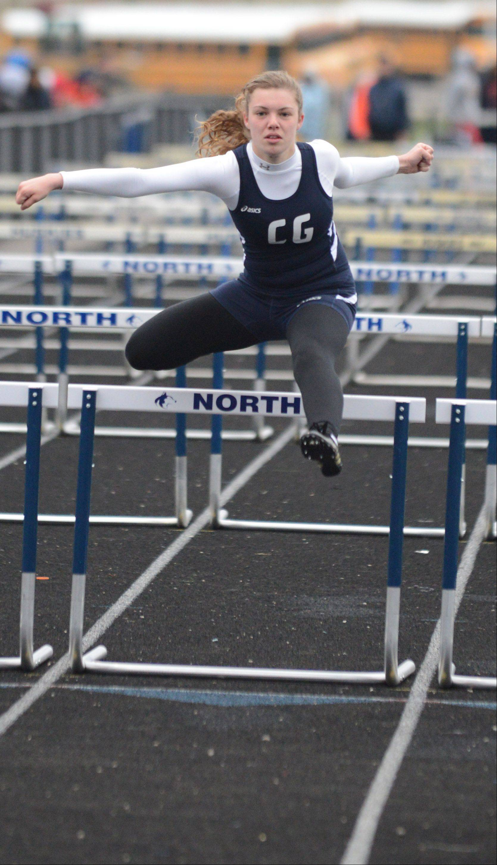 Alicia Brennan of Cary-Grove in the 100-meter hurdles during the Gus Scott track meet at Naperville North on Friday.
