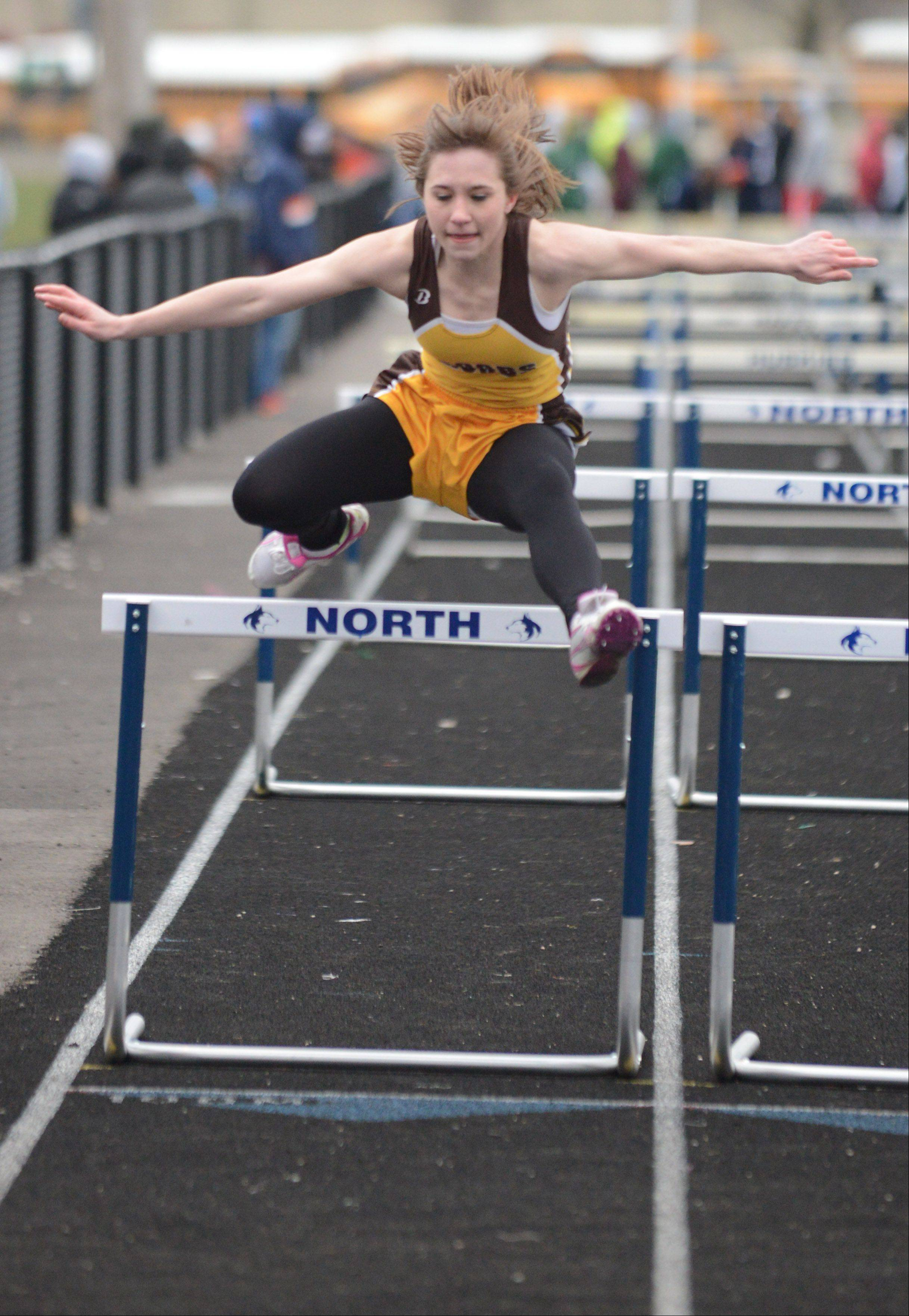 Kira Whittier of Jacobs in the 100-meter hurdles during the Gus Scott track meet at Naperville North on Friday.