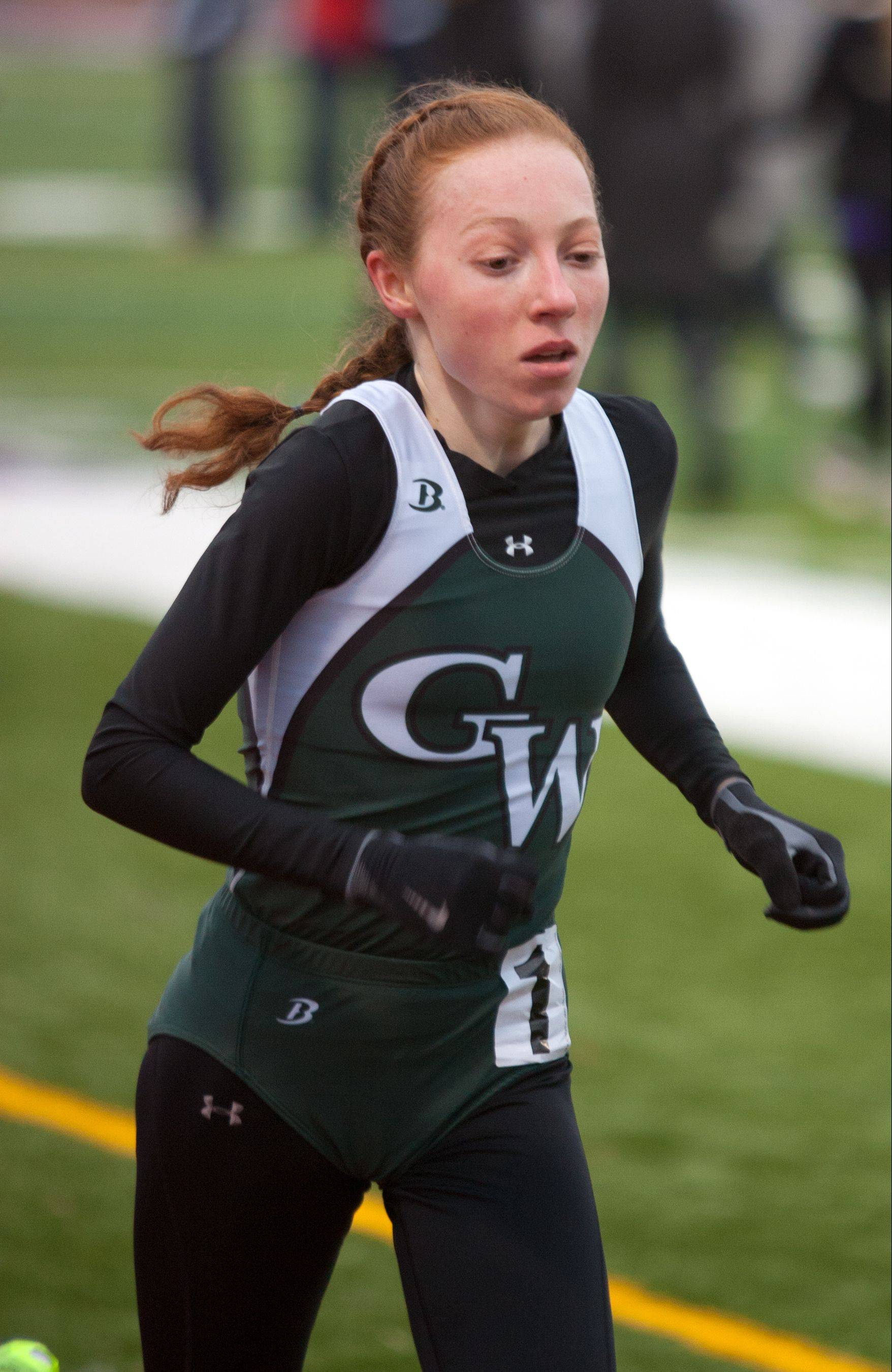 Glenbard West's Madeline Perez wins the 3,200-meter run, setting a personal best time of 10:27.3 at Downers North's invitational Friday.