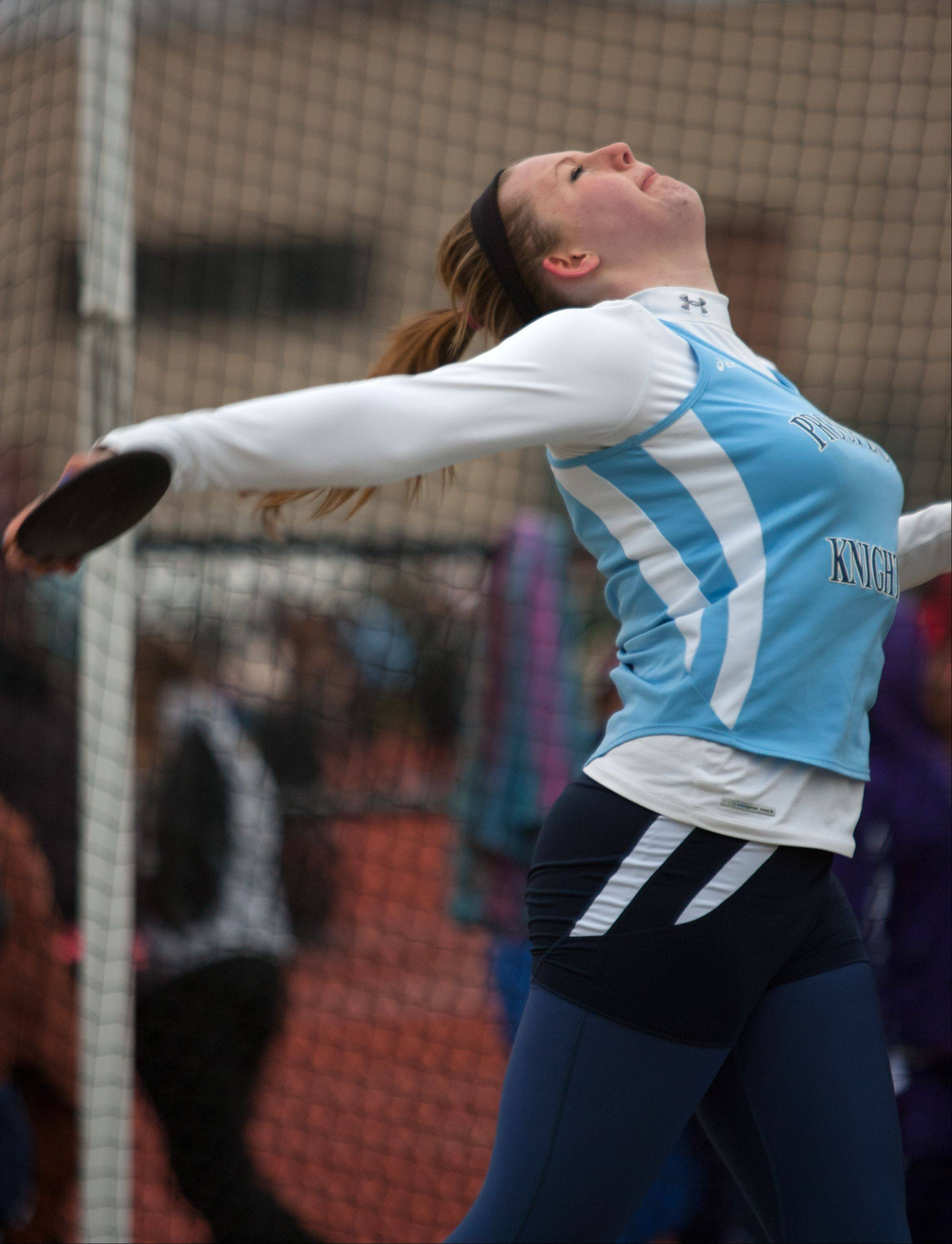Prospect's Erin Reese throws the discus at Downers Grove North's invitational on Friday.