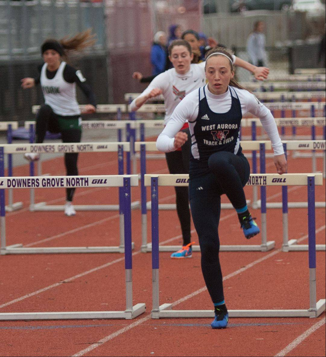 West Aurora's Emma Spagnola wins her heat of the 100-meter hurdles during Downers Grove North's invitational Friday.