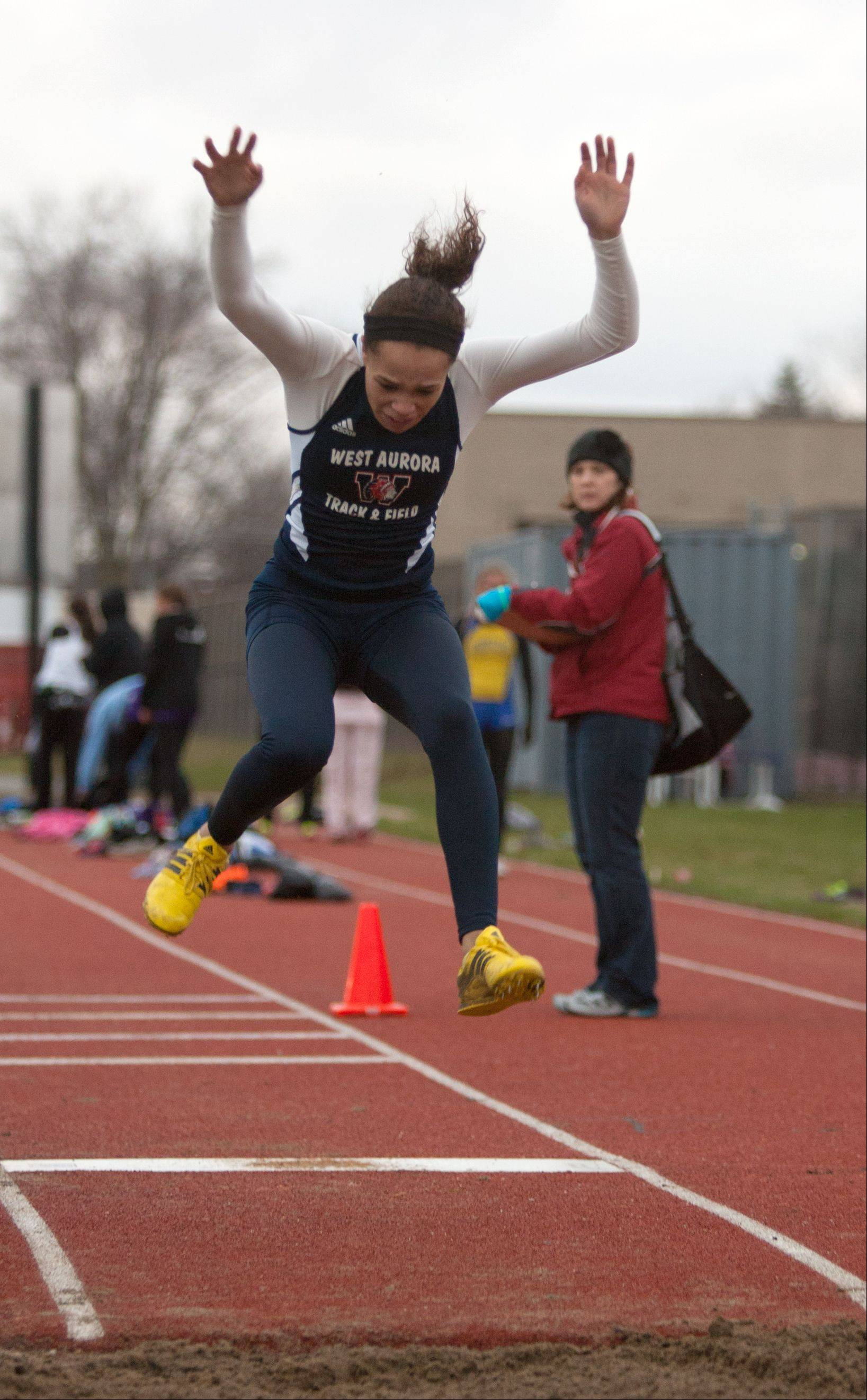 West Aurora's Kyla Walton competes in the triple jump during Downers Grove North's invitational Friday.