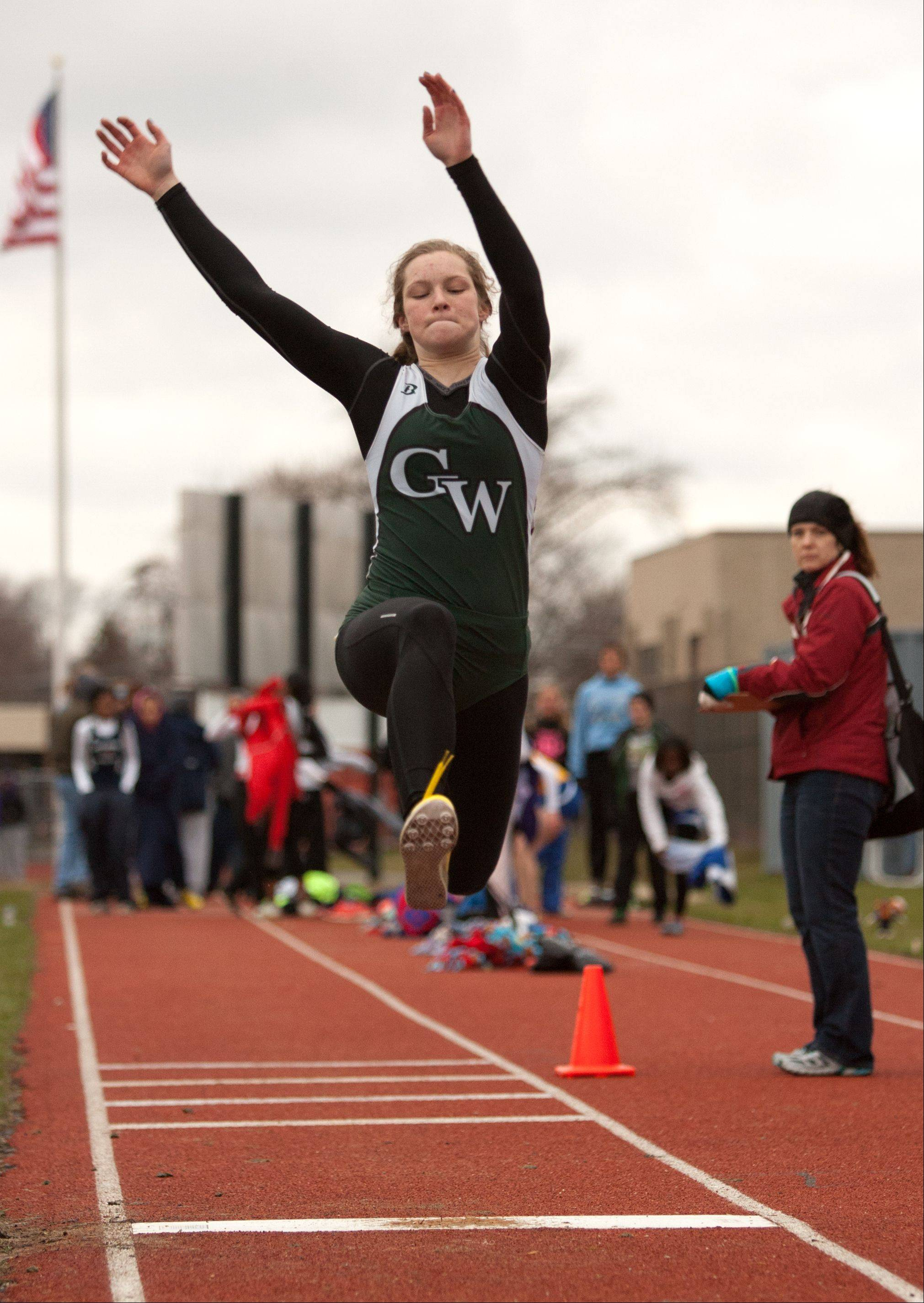 Glenbard West's Emma Gamble competes in the triple jump during Downers Grove North's invitational Friday.