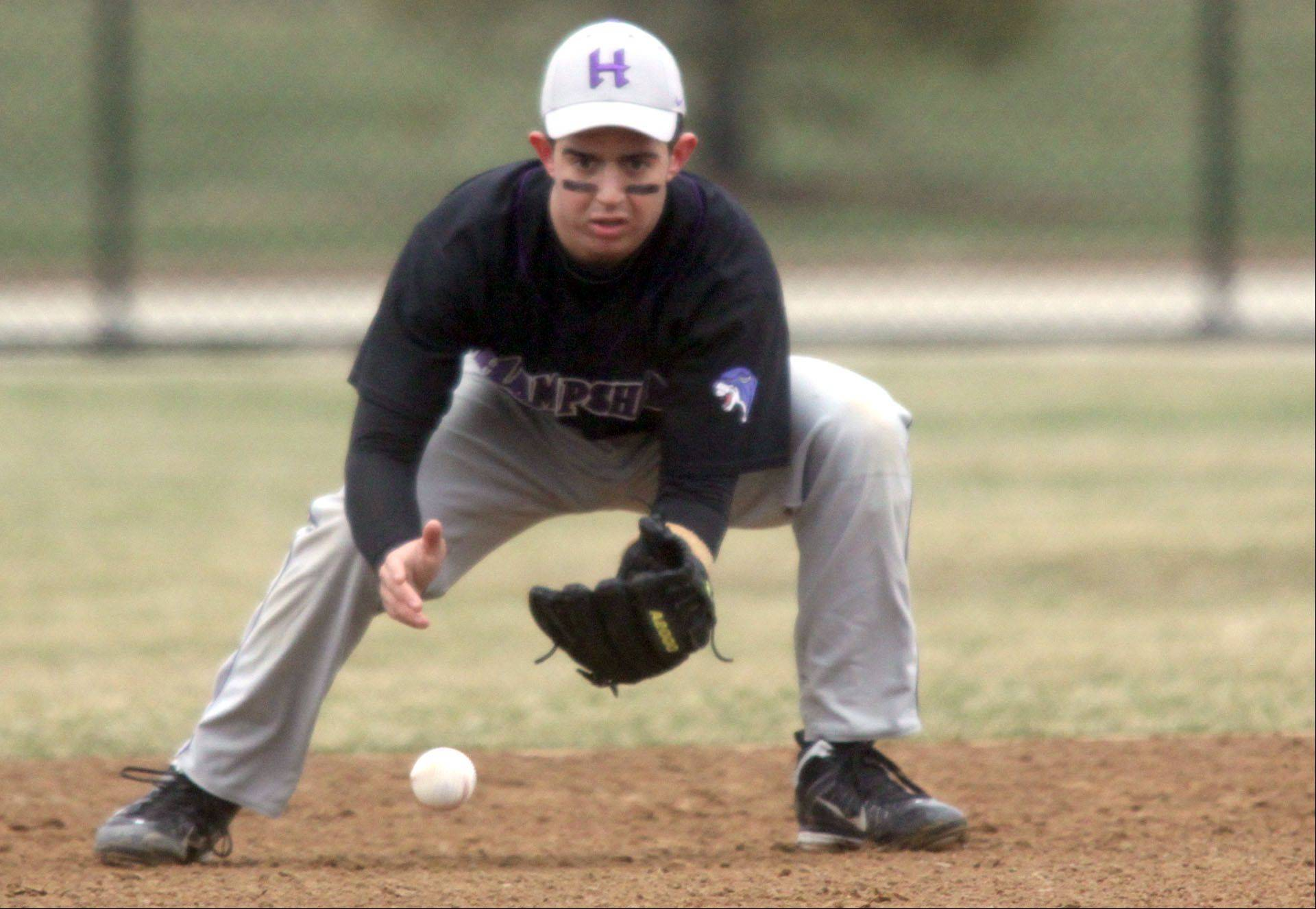 Hampshire's shortstop Michael Laramie gathers a grounder before firing to first base against Dundee-Crown's during a varsity baseball game at Carpentersville on Friday.